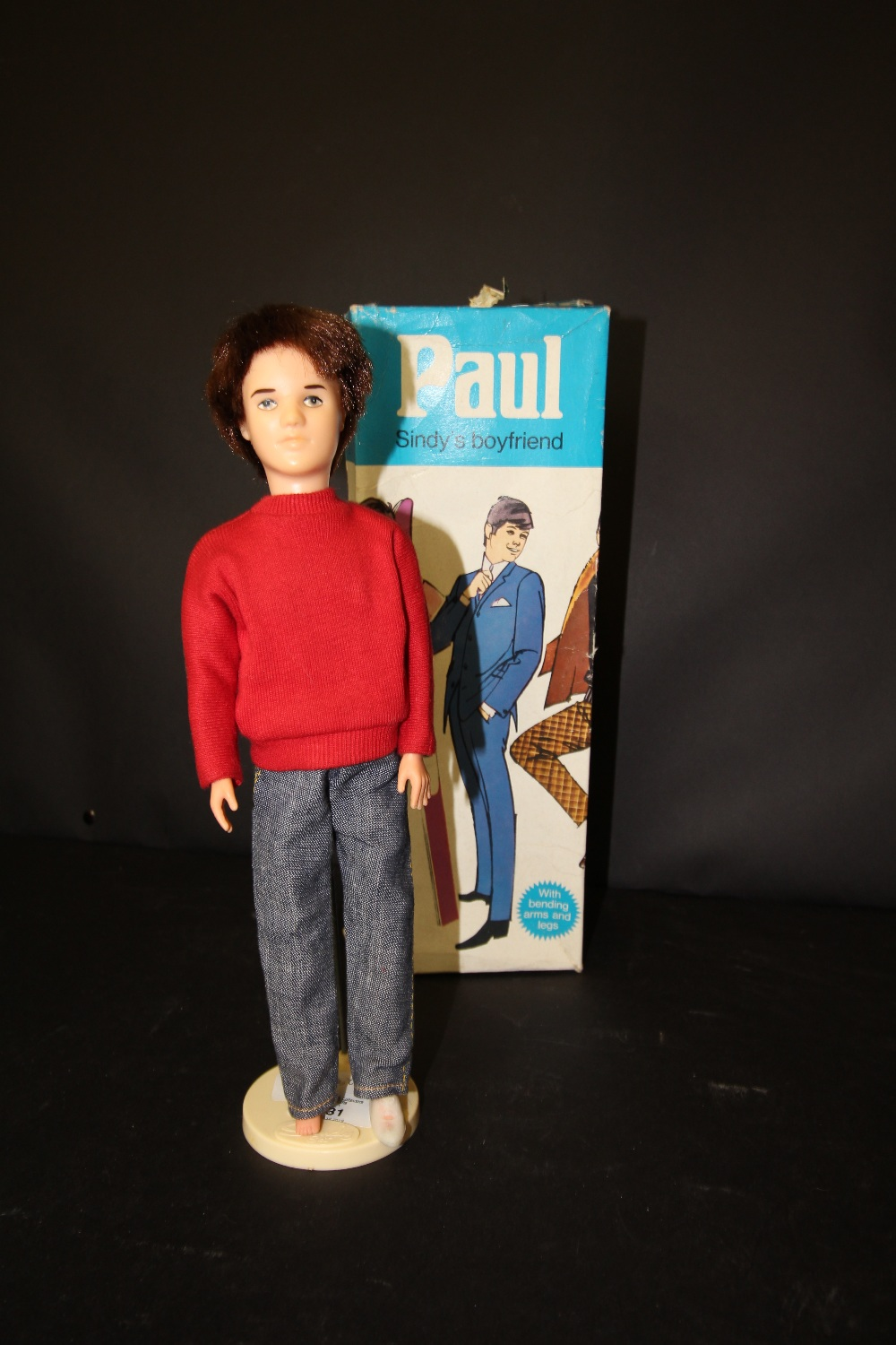 Lot 31 - Paul (Sindy) doll (boxed) and stand