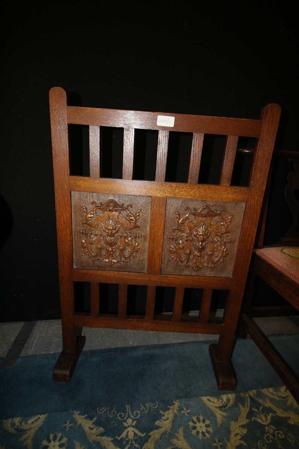 Lot 741 - Carved double iron Arts & Crafts fire screen