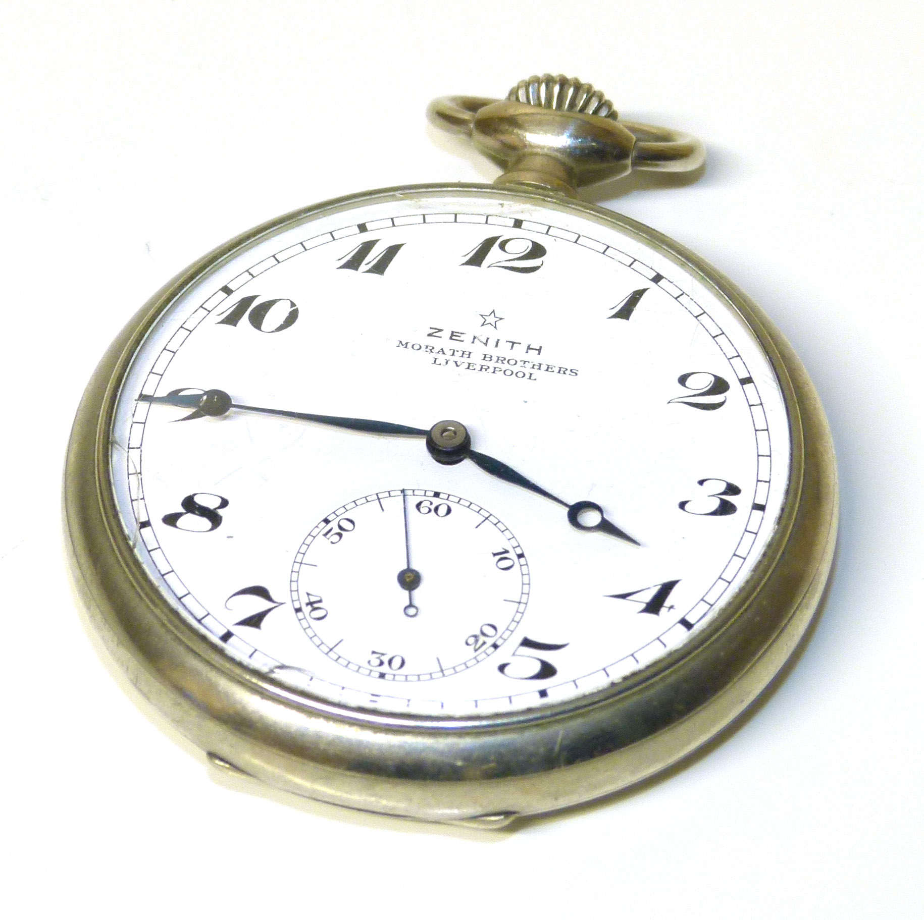 Lot 274 - A Zenith open face pocket watch, the circular signed dial with Arabic hour markers, outer minutes