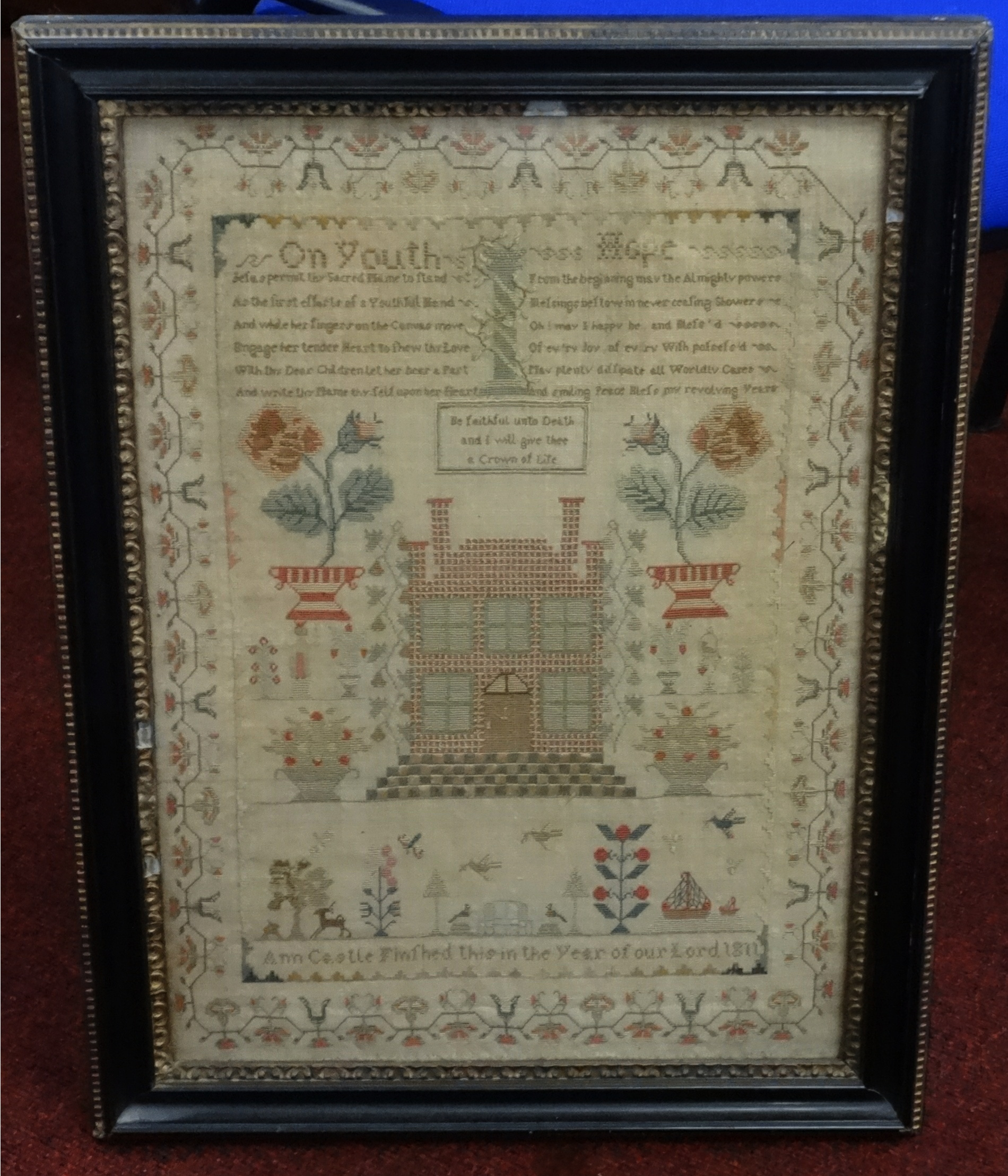 Lot 152 - A 19th century needlework Sampler by Ann Castle, dated 1811, 45cm x 32cm, (the owners grandparents