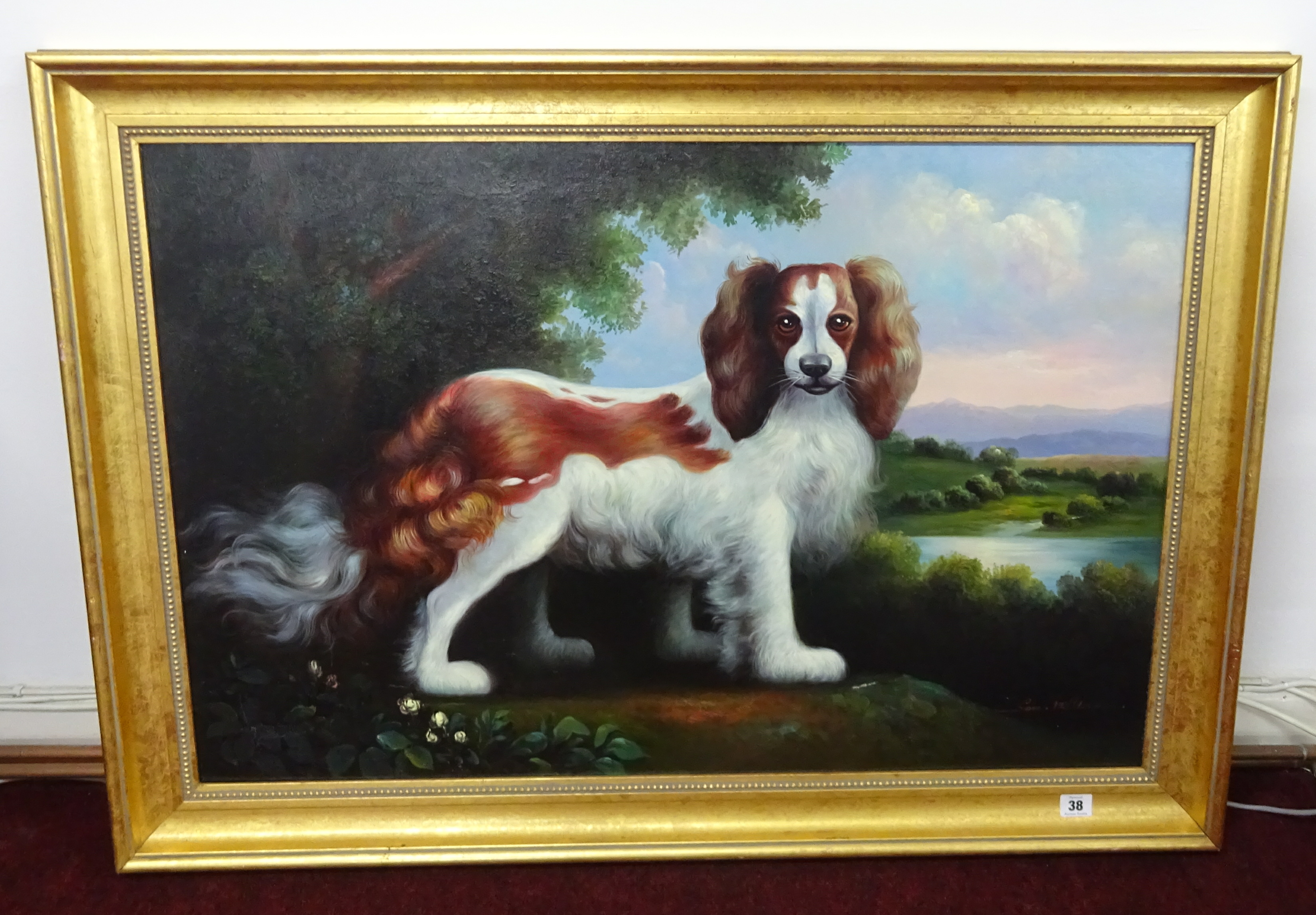 Lot 038 - Sam Miller, 20th century, 'Portrait of a King Charles Spaniel in a landscape', 60cm x 90cm, framed.