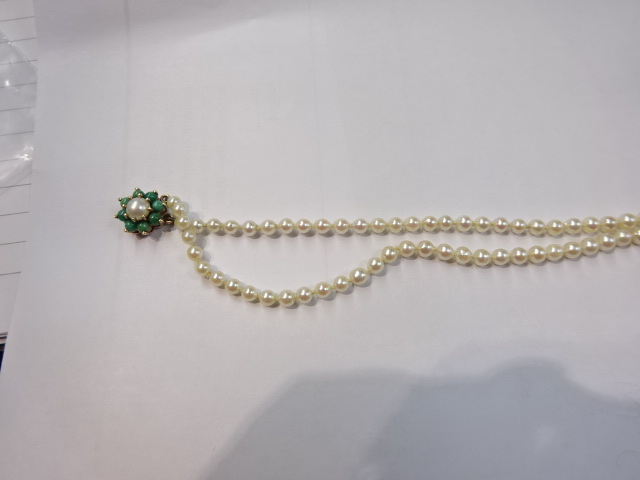 Lot 036 - A string of pearls with 9ct gold clasp.