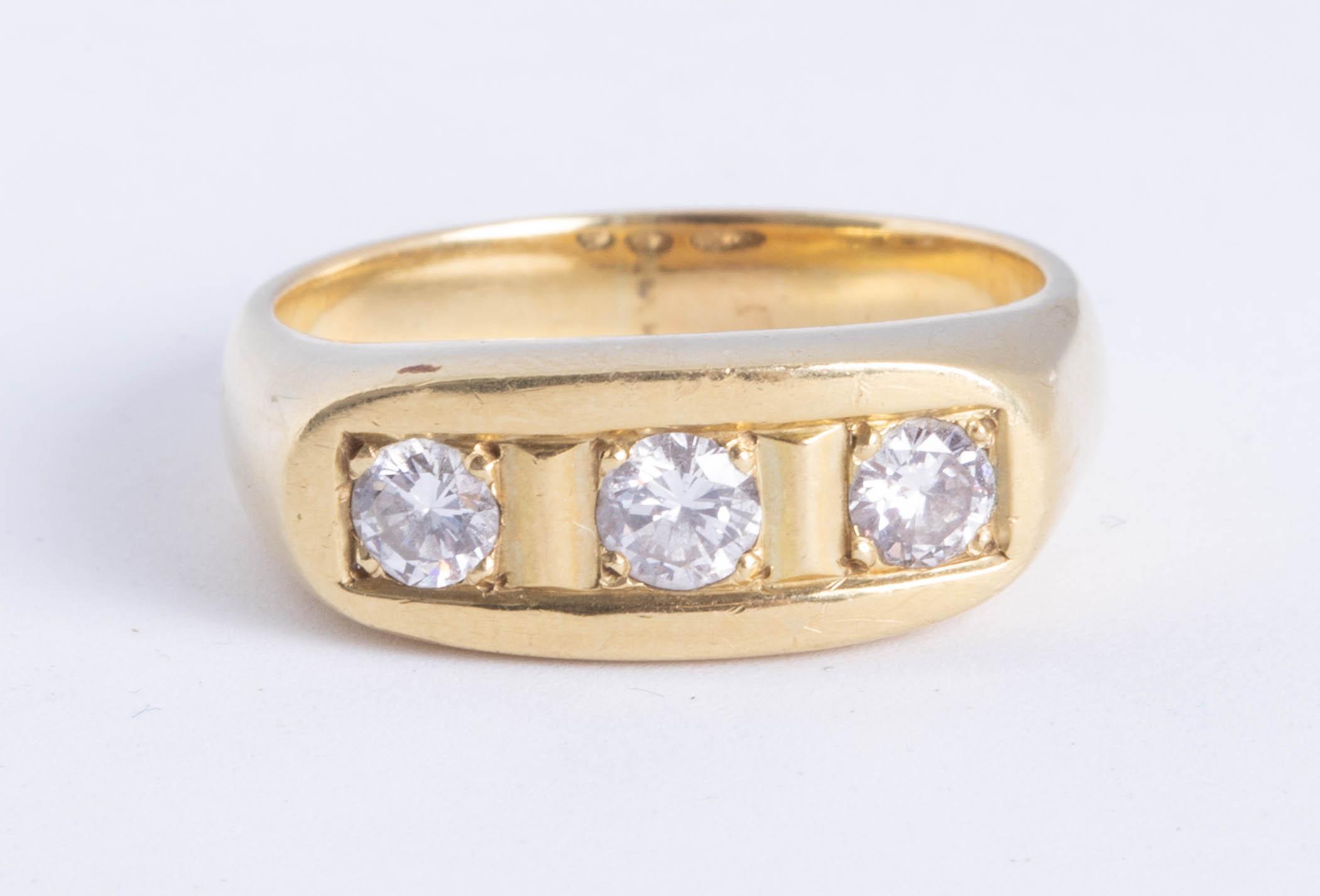 Lot 054 - An 18ct yellow gold diamond three stone ring, approx 60 pts, size U.