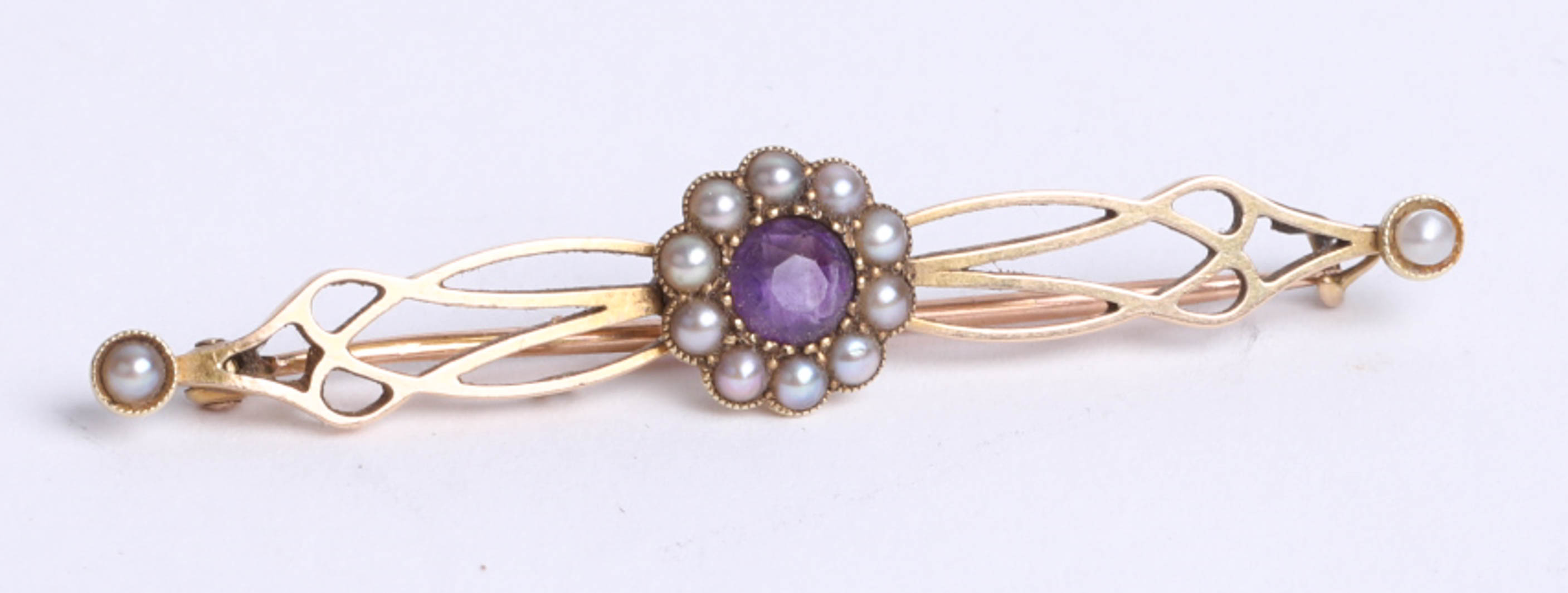 Lot 048 - A 15ct yellow gold pearl set brooch and an unmarked gold knot ring (3.20g) also a white metal