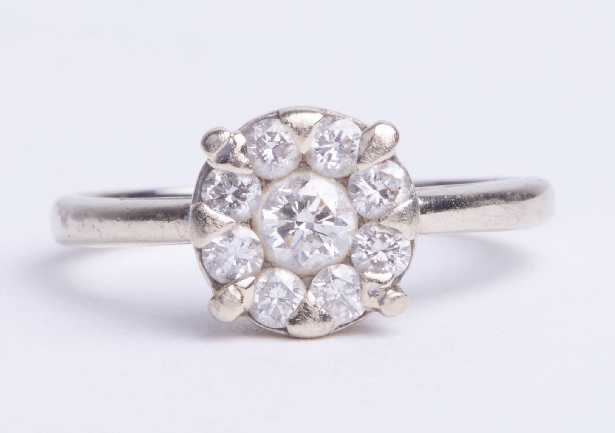 Lot 017 - A 18ct white gold diamond set cluster engagement ring, with insurance valuation (dated 2012)