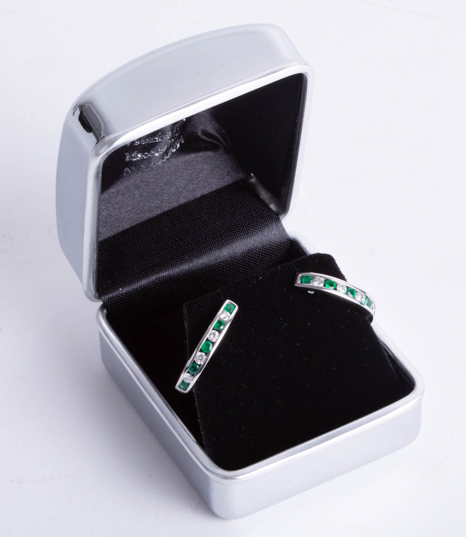 Lot 014 - A pair 14ct white gold diamond and emerald hoop earrings.