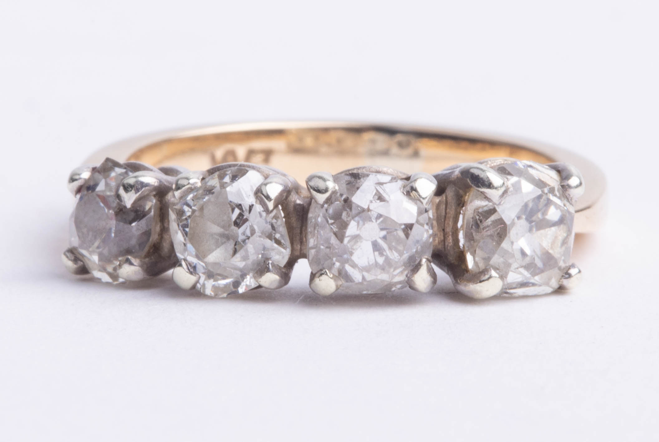 Lot 018 - An 18ct four stone diamond ring, set with old cut round diamonds, size M.
