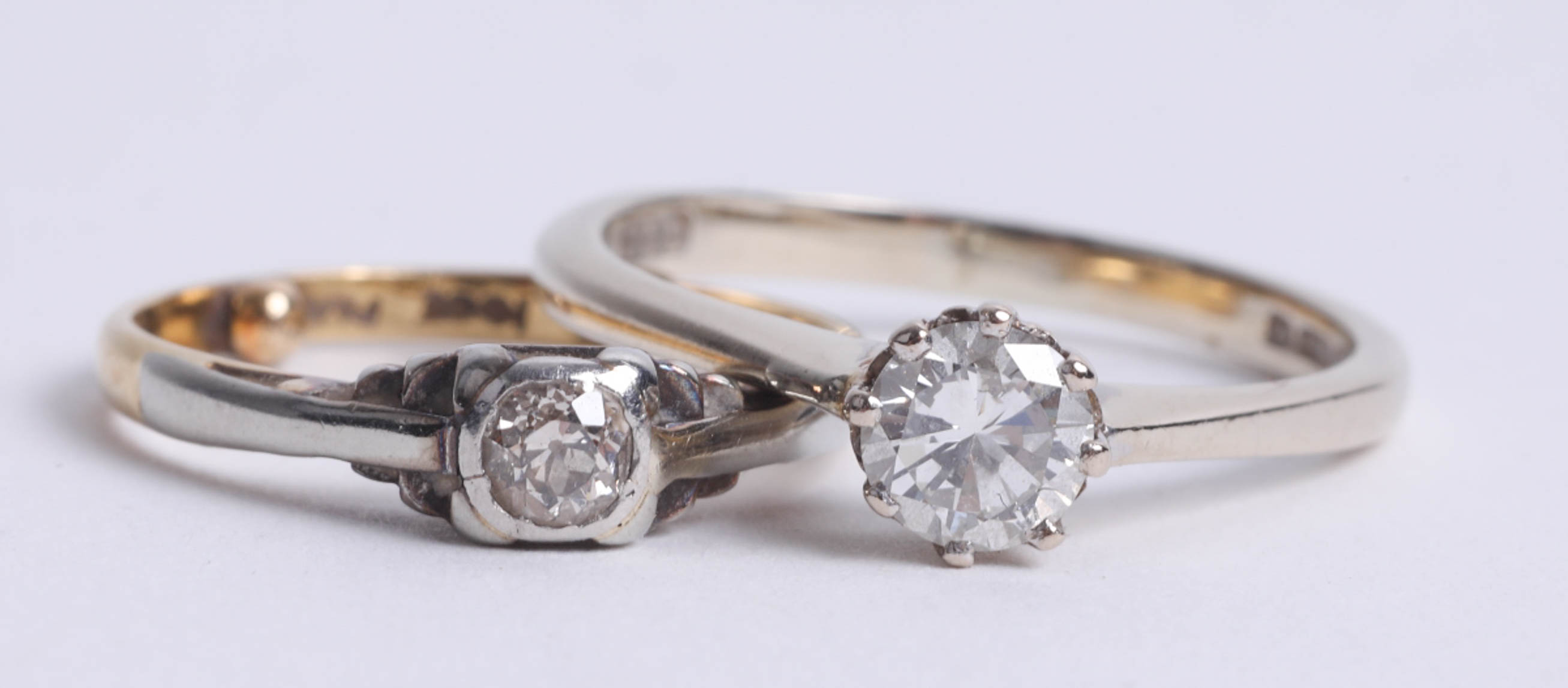 Lot 007 - An 18ct white gold and diamond set solitaire ring and another (2).