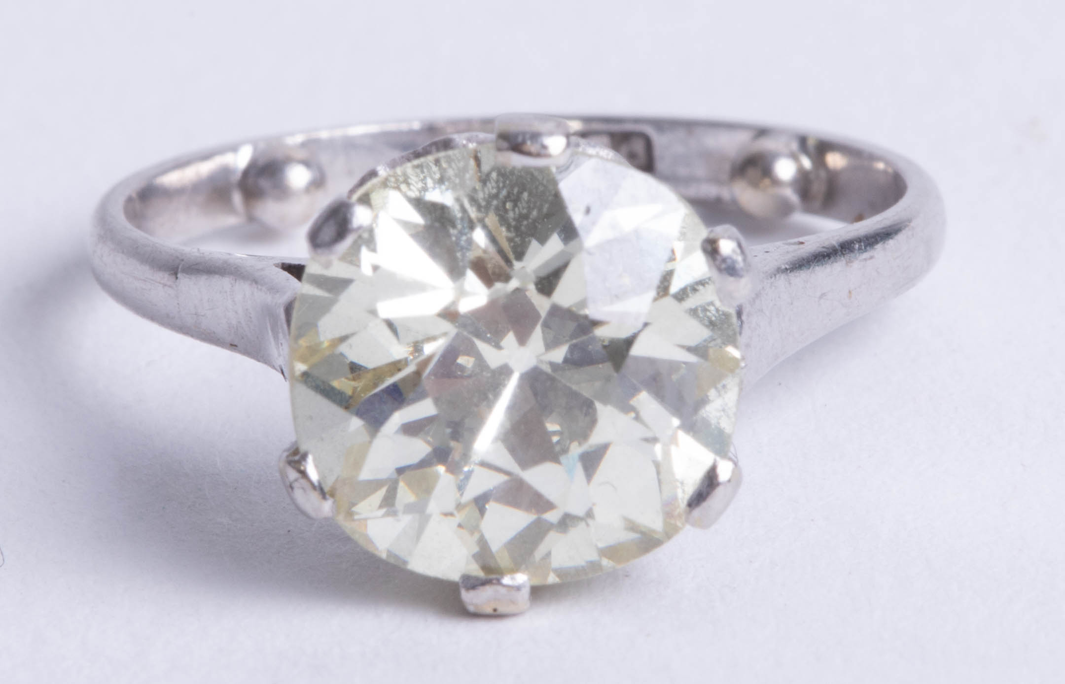 Lot 051 - A large diamond solitaire ring, approx 3.56 carats, cushion shaped and old brilliant cut diamond,