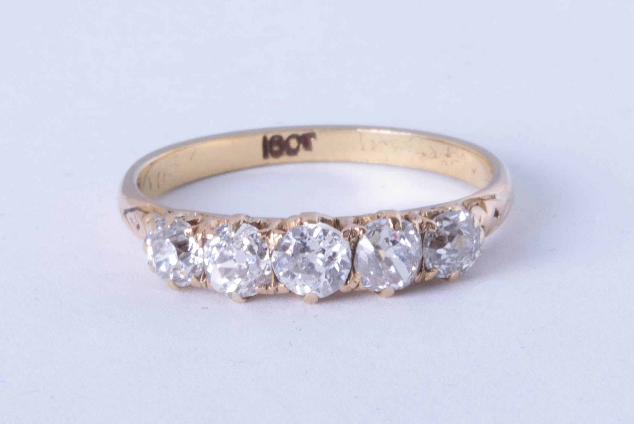Lot 058 - A diamond five stone ring, approx 80 pts, size Q.