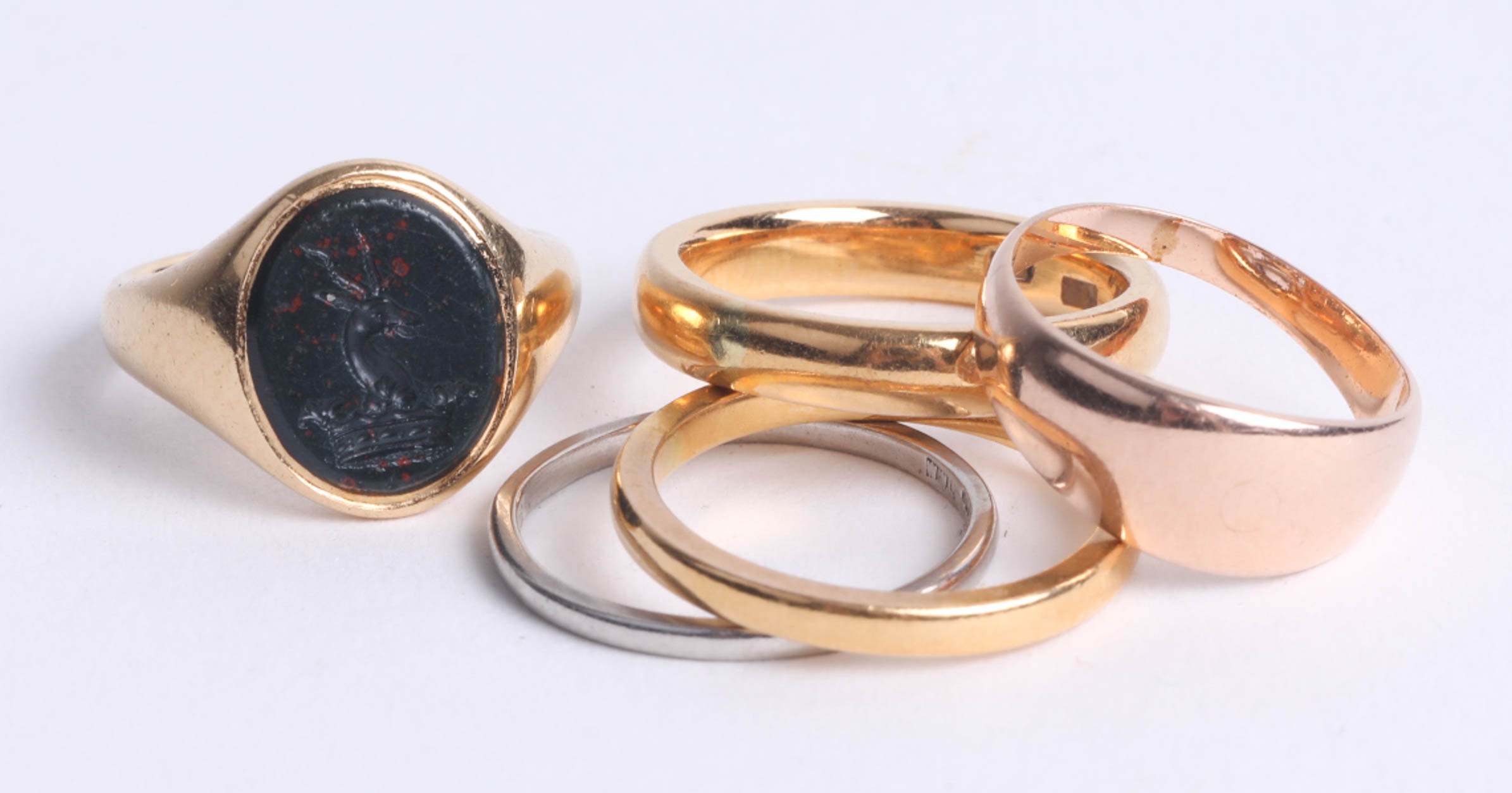 Lot 006 - A 9ct signet ring 6.2g, a 22ct wedding band 3.1g and three other various rings including platinum