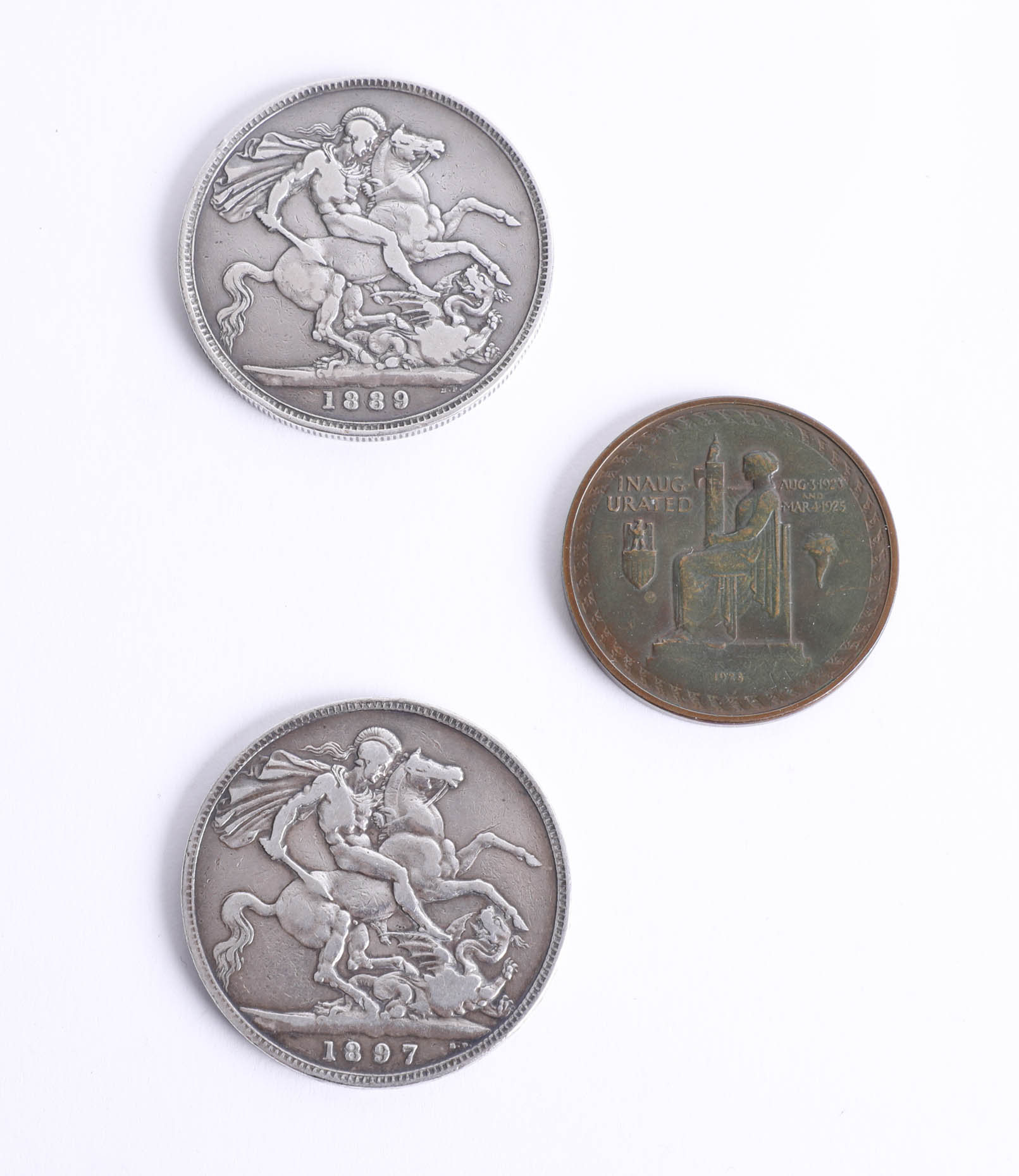 Lot 018 - Two Victorian silver crowns dated 1889 and 1897 together with a 1928 Calvin Coolidge coin (3).