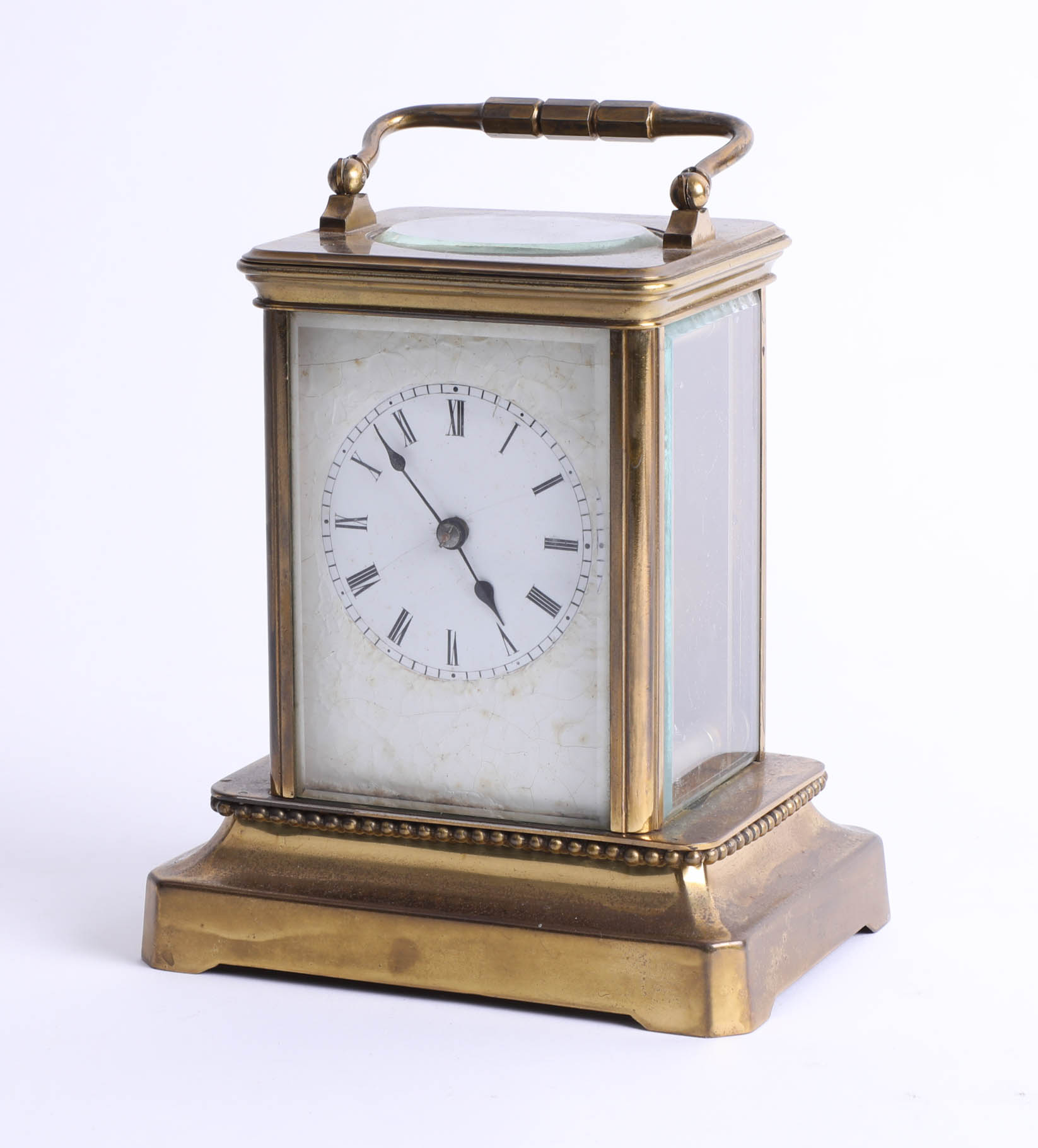 Lot 024 - A brass carriage clock on base, maker unknown, height 15cm.