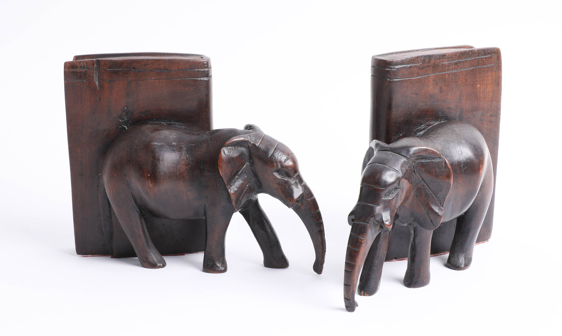 Lot 012 - A pair of carved wooden elephant bookends.