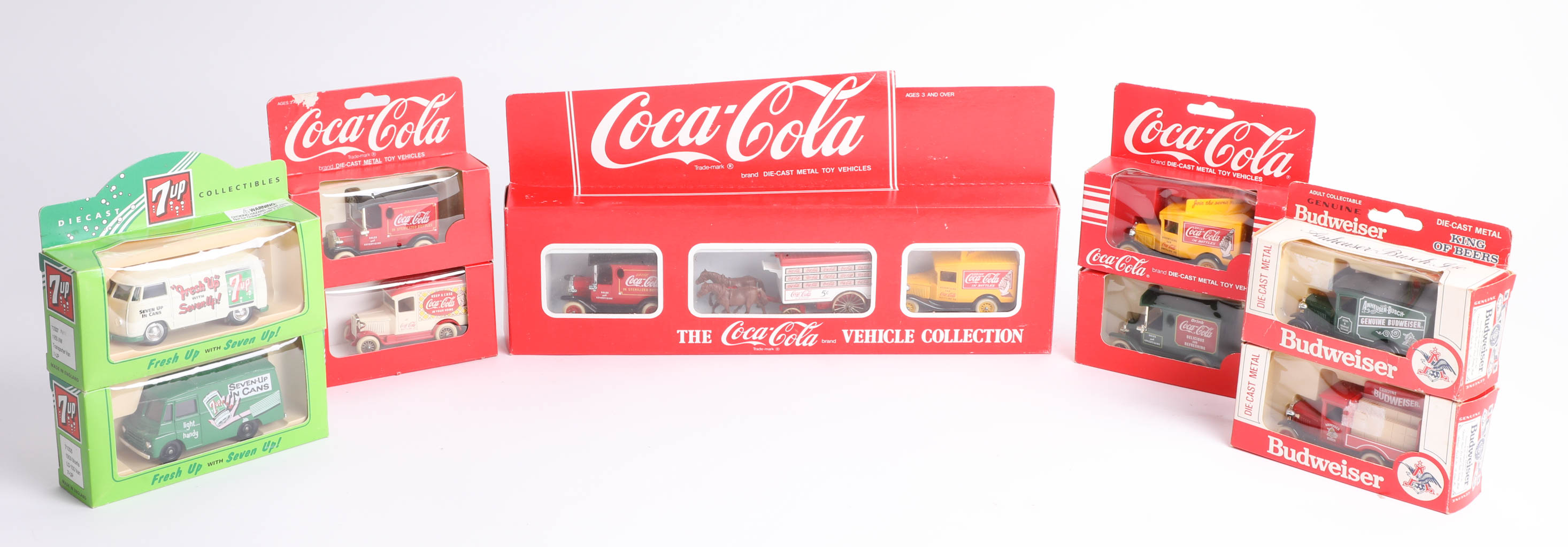 Lot 040 - Thirty-two advertising diecast cars, including twenty-five 'Coca Cola', five '7-Up' and two '