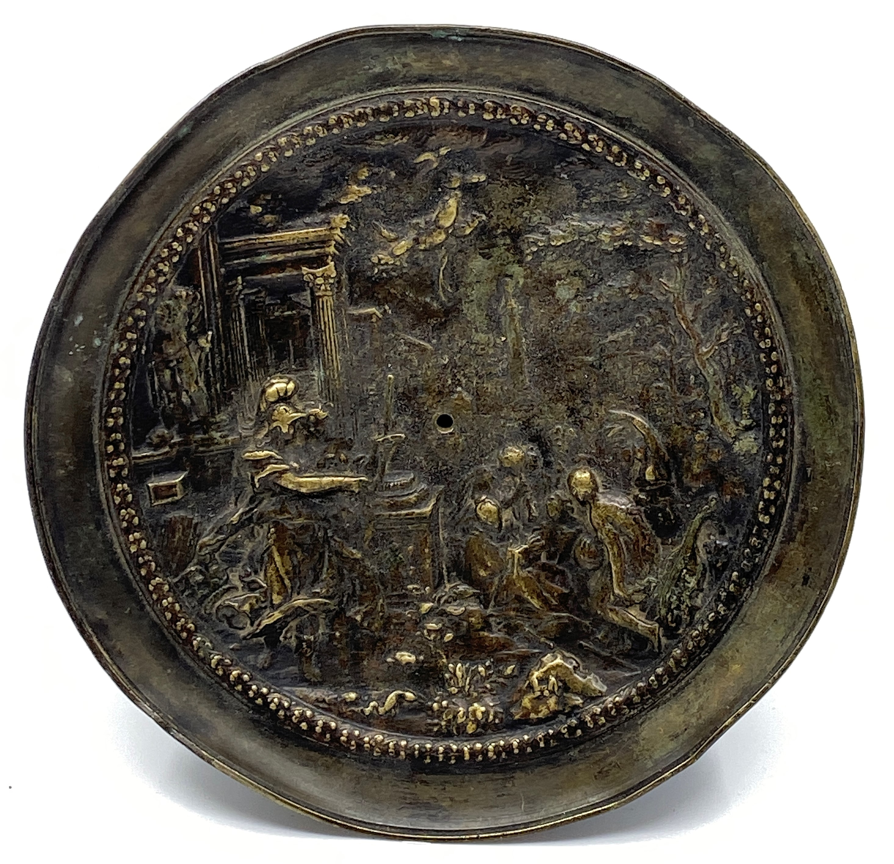 Lot 193 - A circular bronze dish depicting Roman figures amongst pillared buildings and statues (diameter 17.