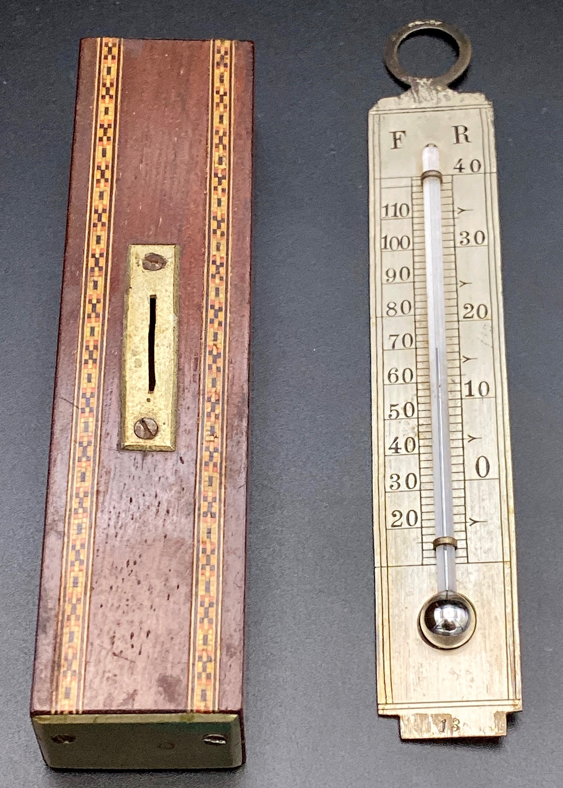 Lot 191 - A Tunbridge ware desk thermometer, the silvered metal scale graduated in Fahrenheit and Reaumur, the