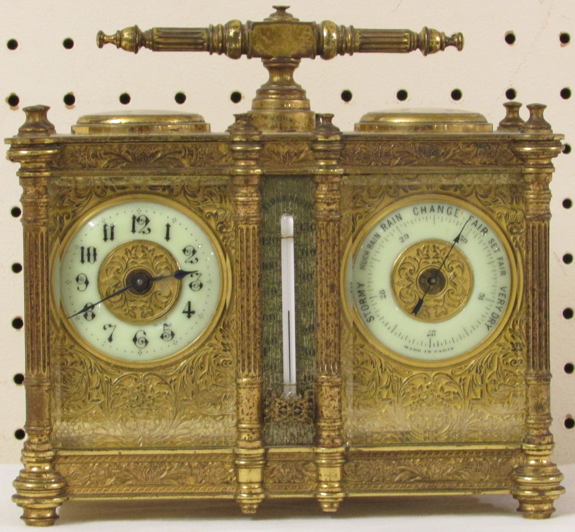 Lot 337 - A 19th century heavily chased brass and gilded bevelled glass combination carriage clock housing