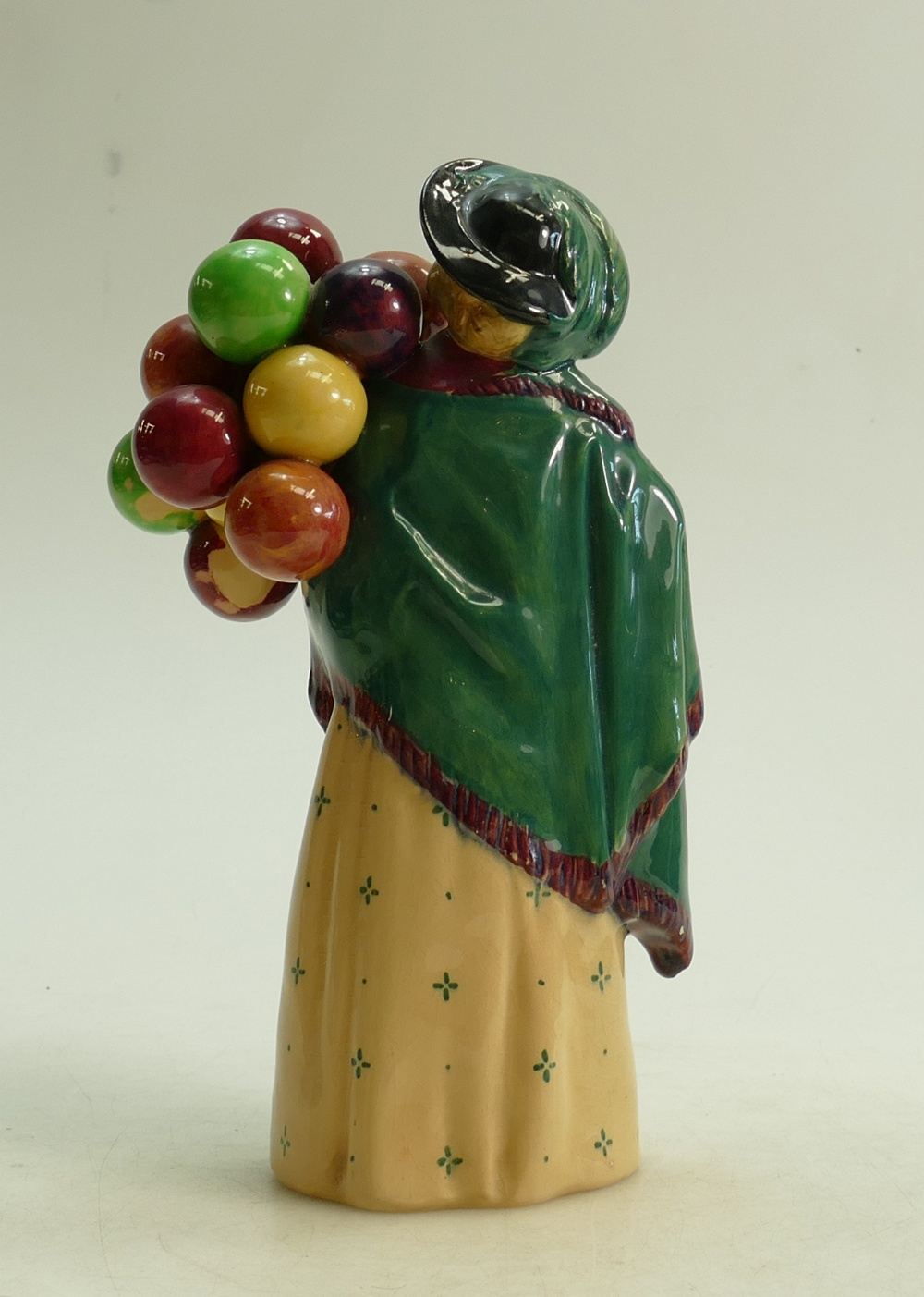 Lot 44 - Royal Doulton figure The Balloon Seller HN583: Factory paint issue to back of balloons
