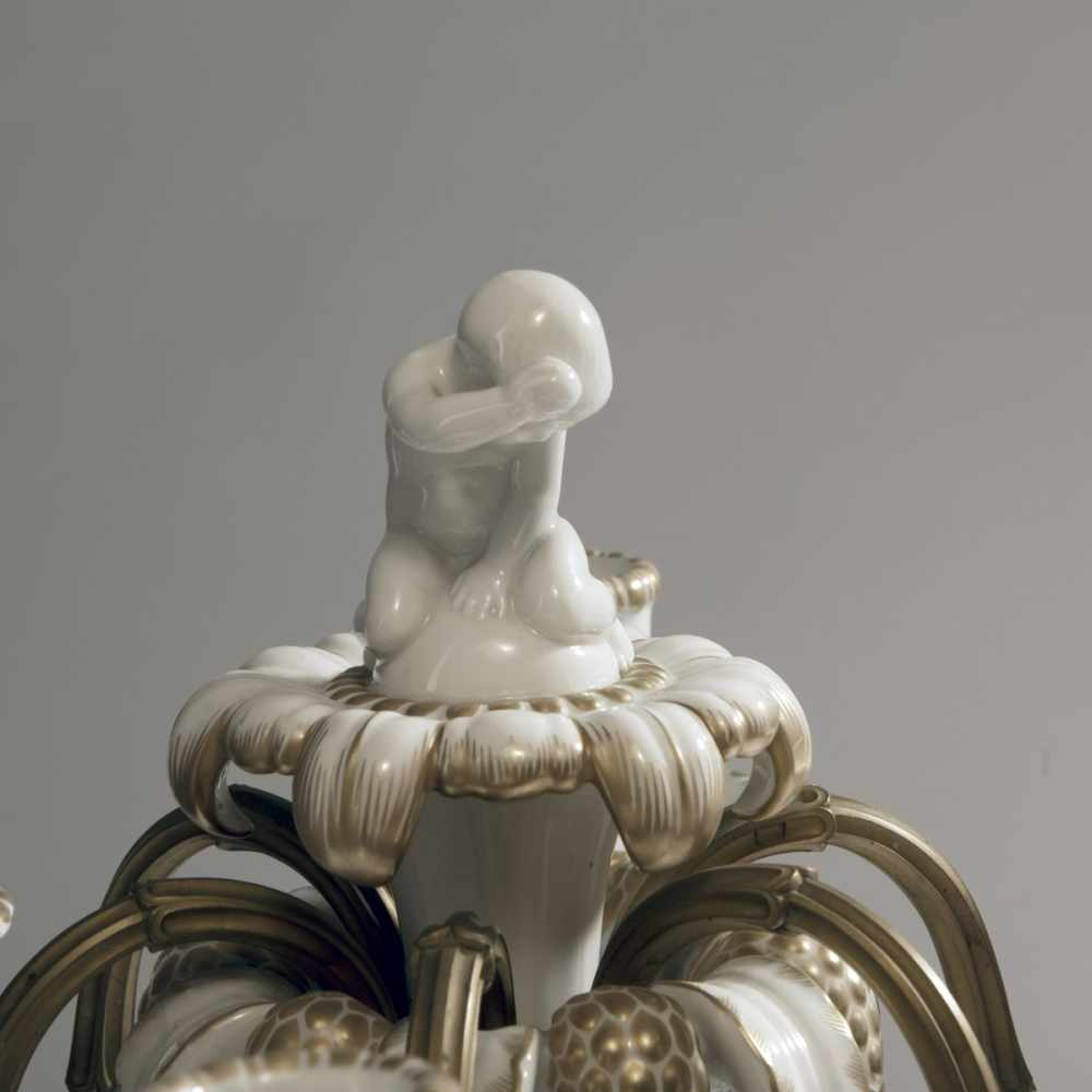 Lot 33 - Adolph Amberg, Candelabrum, 1908Candelabrum, 1908Naked, eating little boy sitting on a blossom on