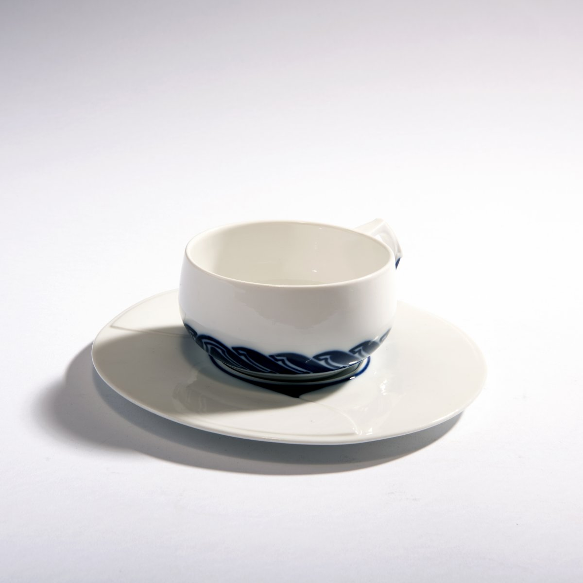 Lot 24 - Henry van de Velde, Teacup and saucer, 1903/04Teacup and saucer, 1903/04H. 5.8 cm. Made by KPM