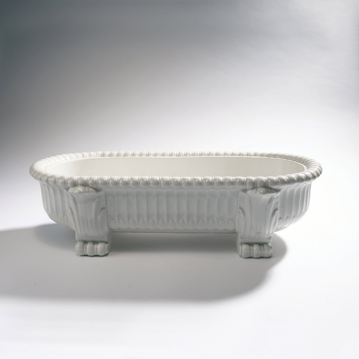 Lot 35 - Adolph Amberg, Jardiniere, 1908Jardiniere, 1908H. 14 cm, 51.5 x 26.5 cm. Made by StPM Berlin, in