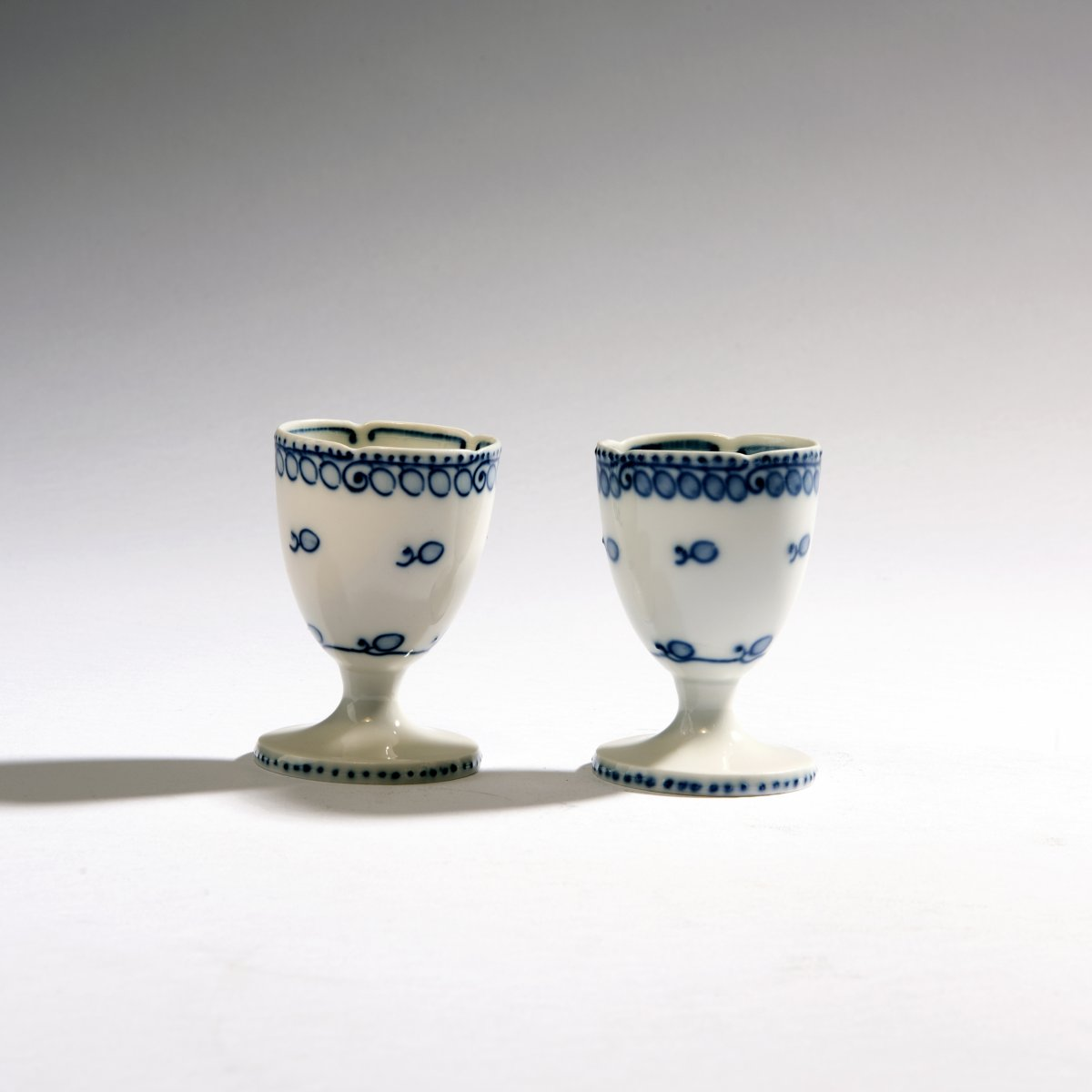 Lot 26 - Richard Riemerschmid, Two eggcups, 1903/04Two eggcups, 1903/04H. 6.9-7 cm. Made by StPM Meissen,