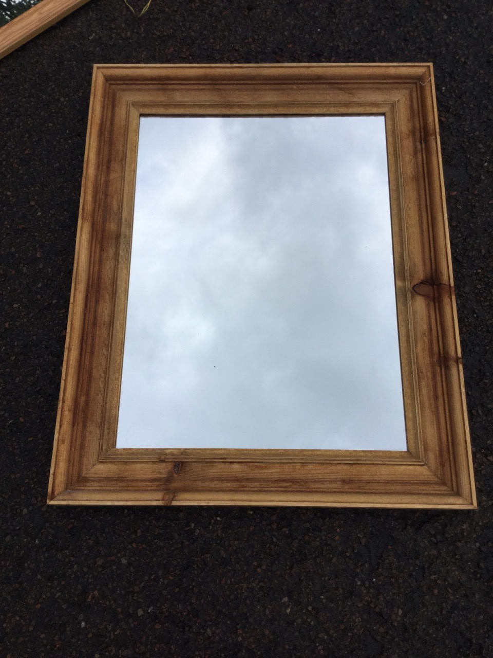 Lot 23 - A modern rectangular pine framed mirror; and another in moulded pine frame. (2)