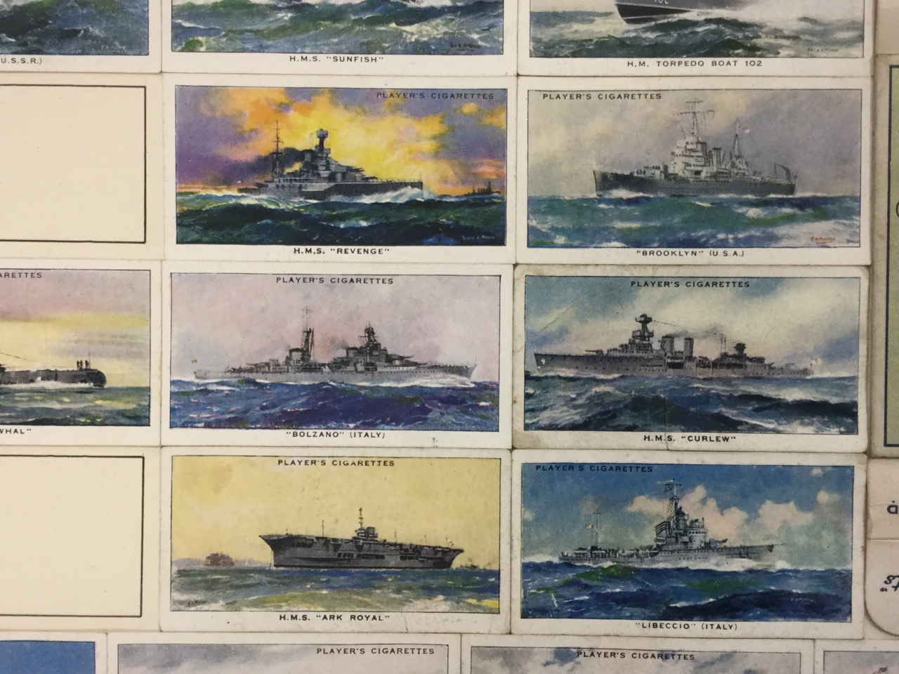 Lot 13 - A framed collection of John Player Modern Naval Craft cigarette cards, mounted with a packet of