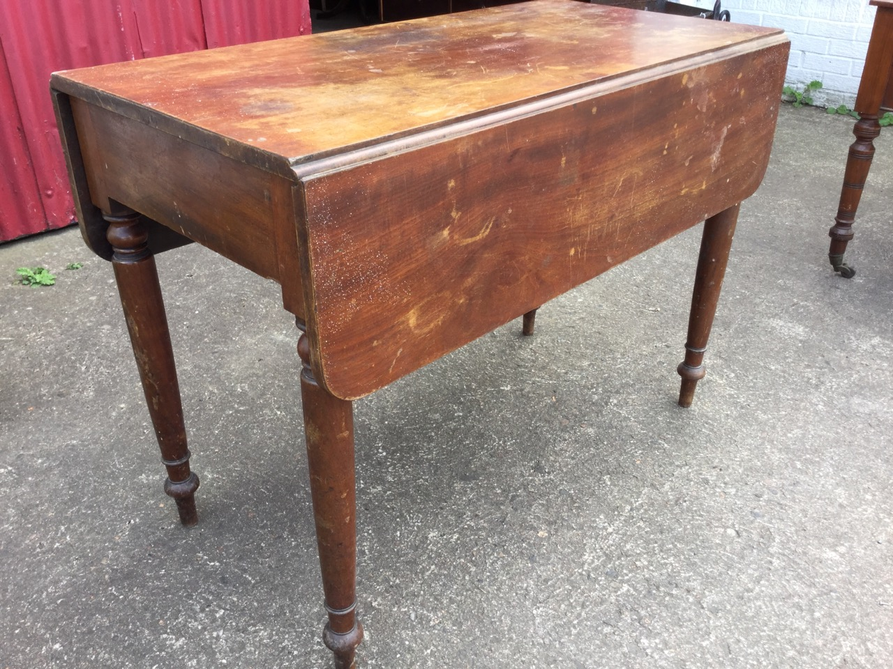 Lot 2 - A Victorian mahogany pembroke table with two rounded drop leaves and frieze drawer, raised on turned