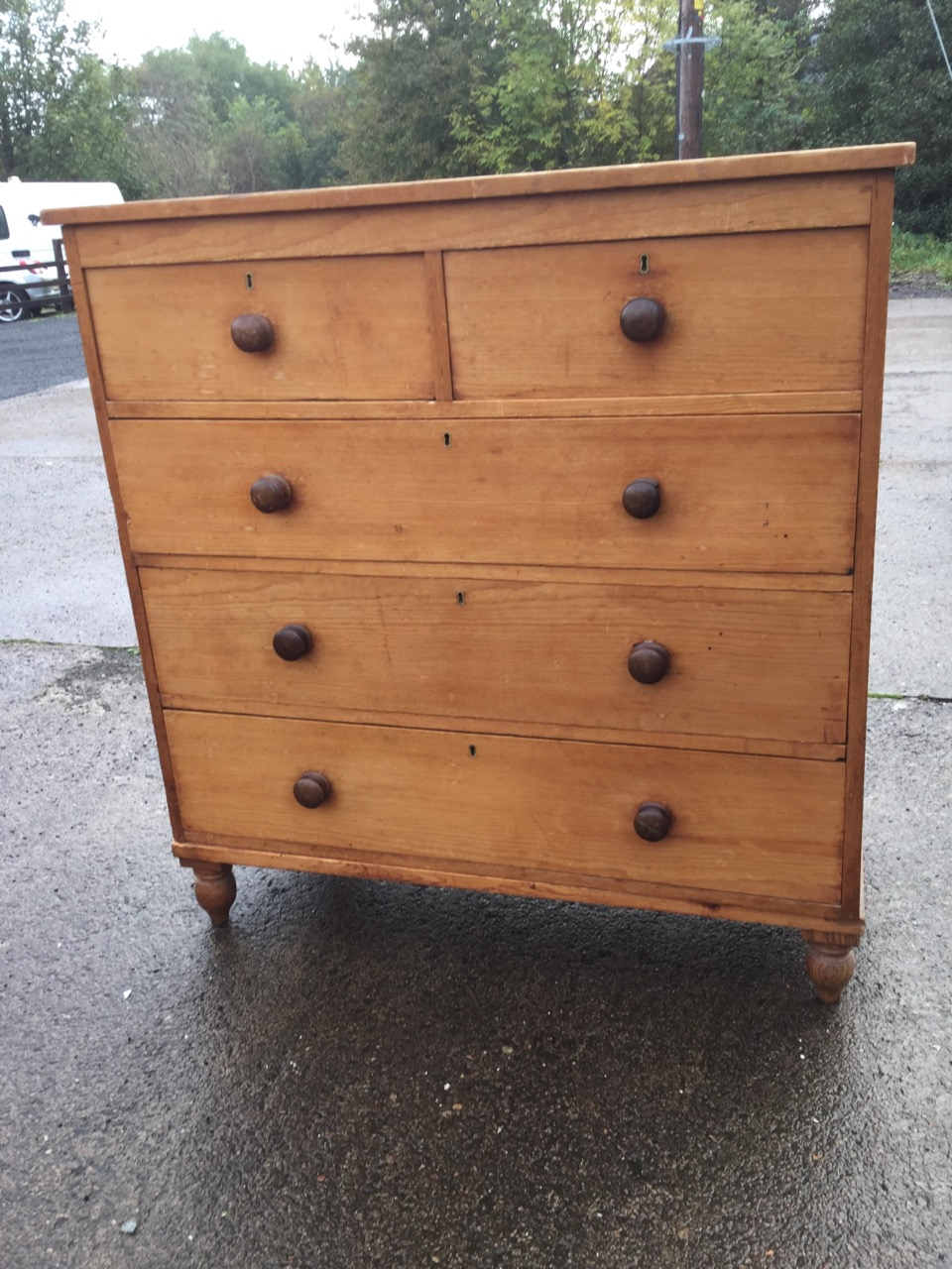 Lot 17 - A Victorian pine chest of drawers with two short and three long drawers mounted with knobs, raised