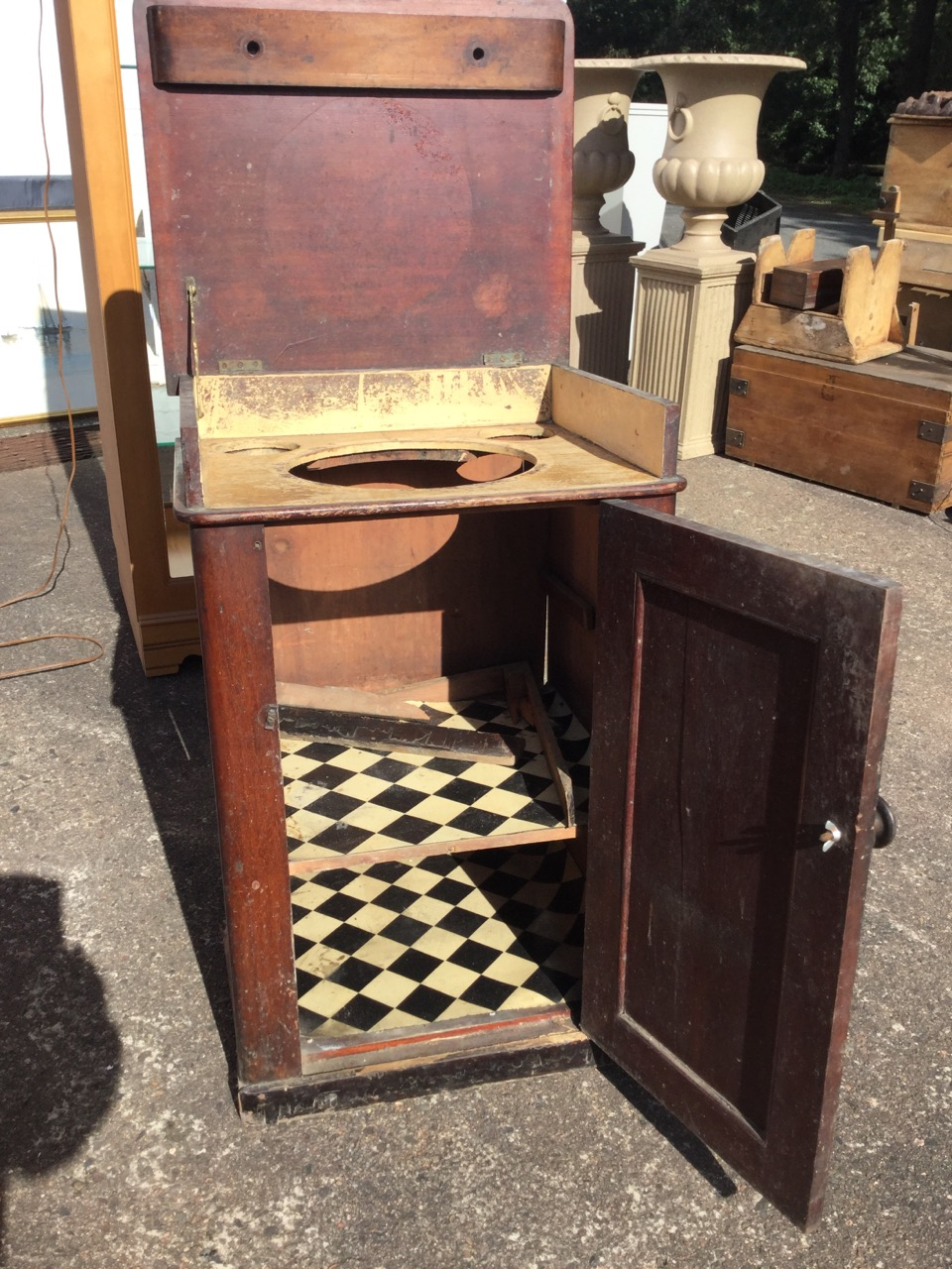 Lot 32 - A nineteenth century mahogany washstand cabinet, the moulded top with dummy drawer revealing an
