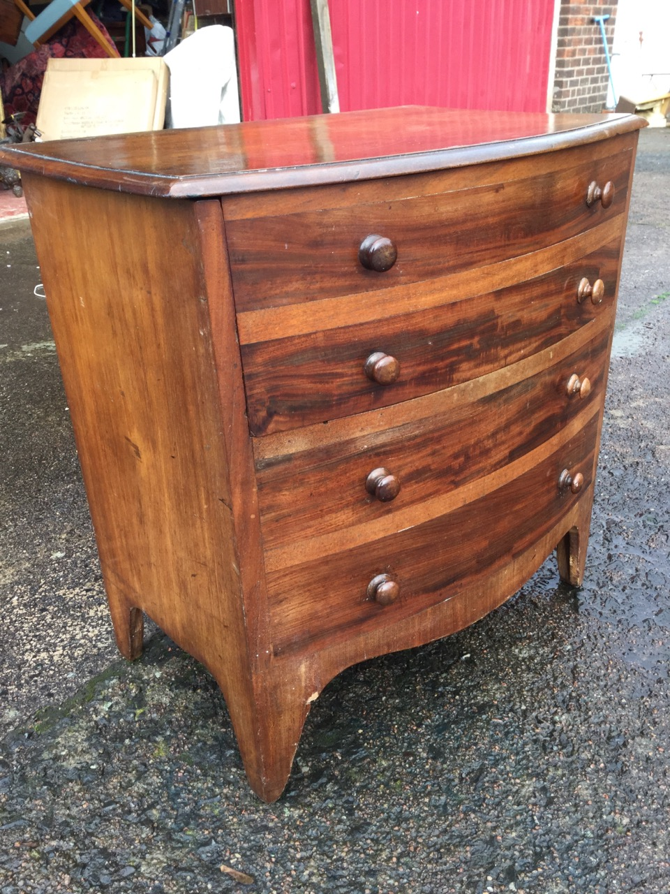 Lot 38 - A Victorian mahogany commode, the bowfronted moulded top above four dummy knobbed drawers, having