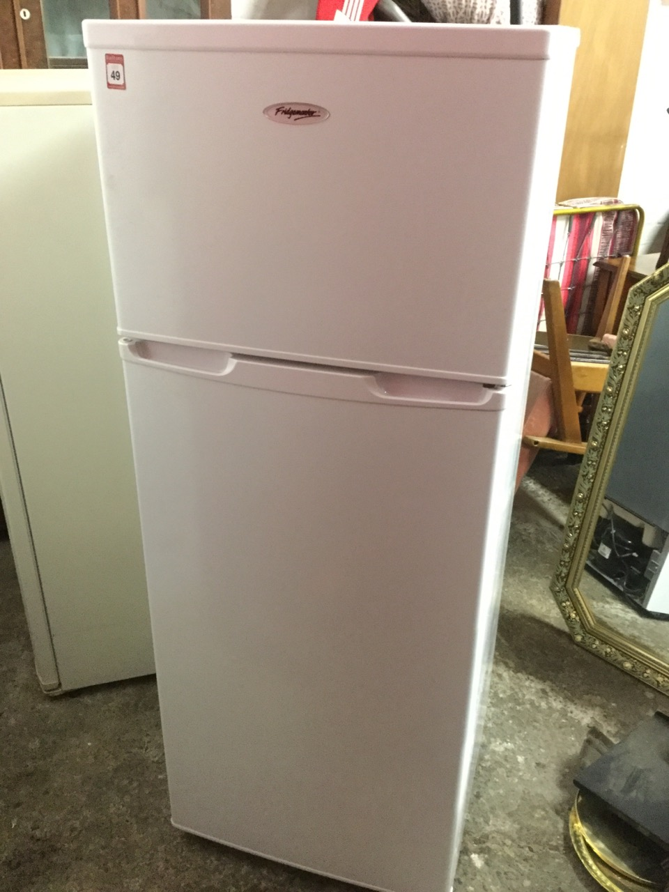 Lot 49 - A square Fridgemaster fridge freezer with two doors. (22in x 22in x 56.75in)