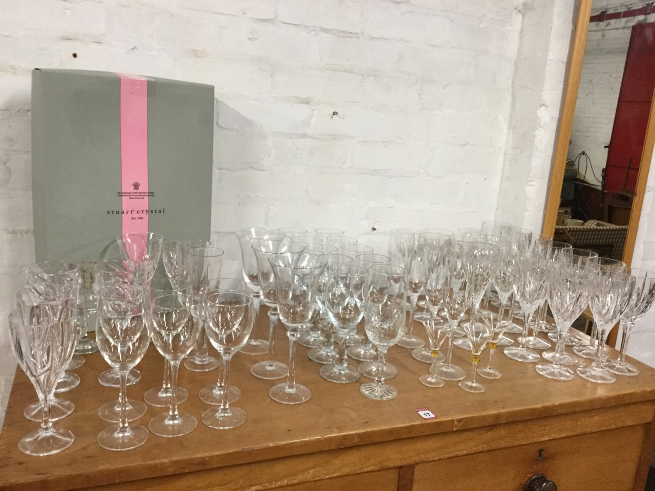 Lot 56 - A quantity of drinking glasses, mainly in sets including 23 flute cut wine glasses, pairs,