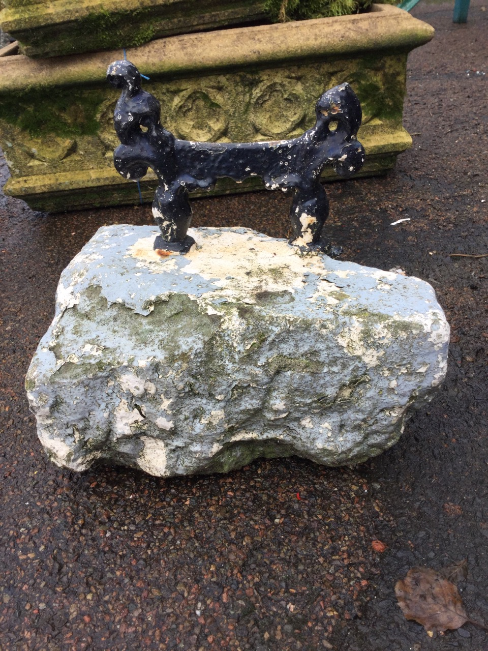 Lot 35 - A Victorian painted cast iron bootscraper, the scrolled blade set into a stone block. (12in x 10in x