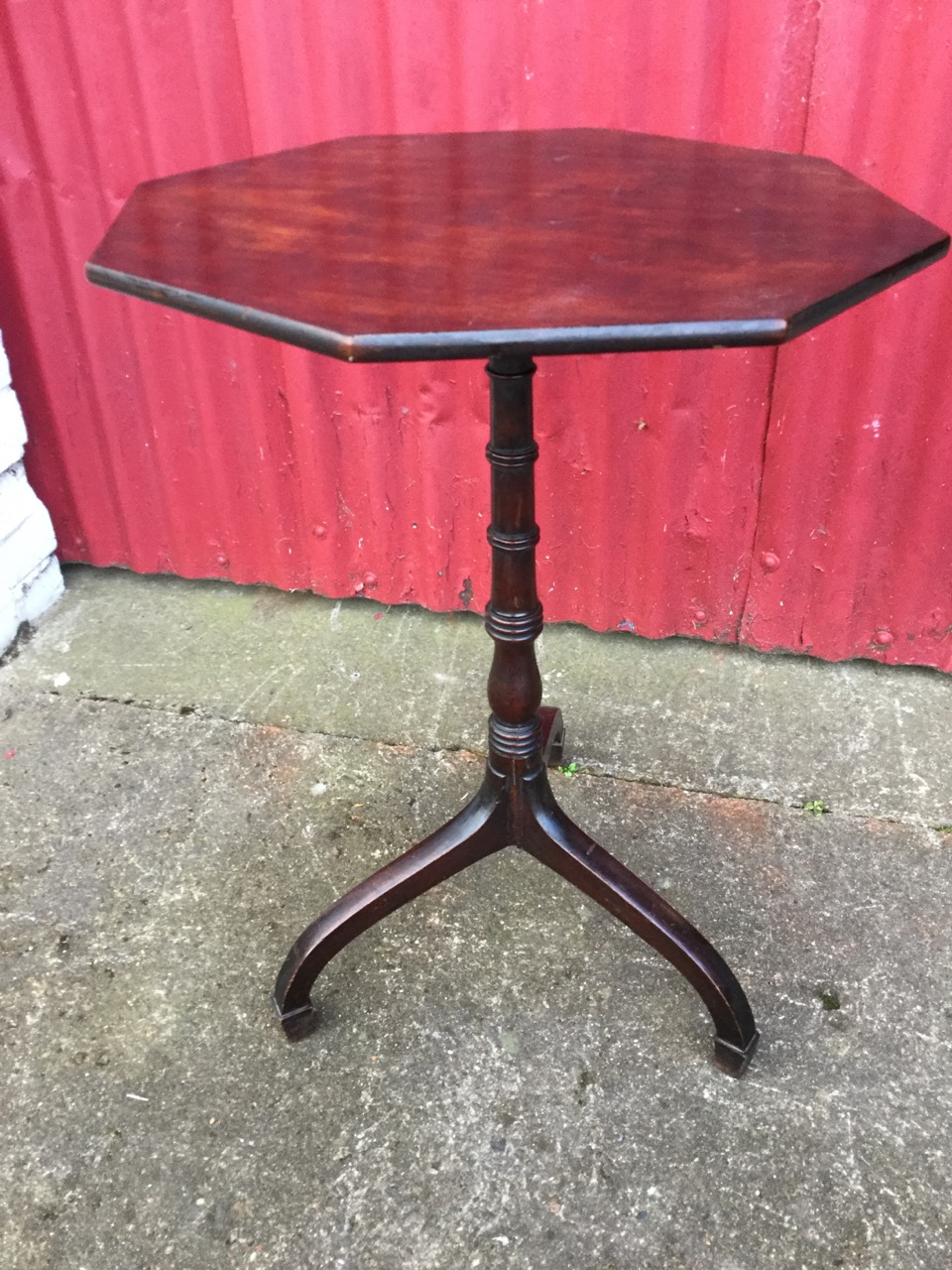 Lot 54 - A Victorian octagonal mahogany occasional table, the top on ring-turned column with square