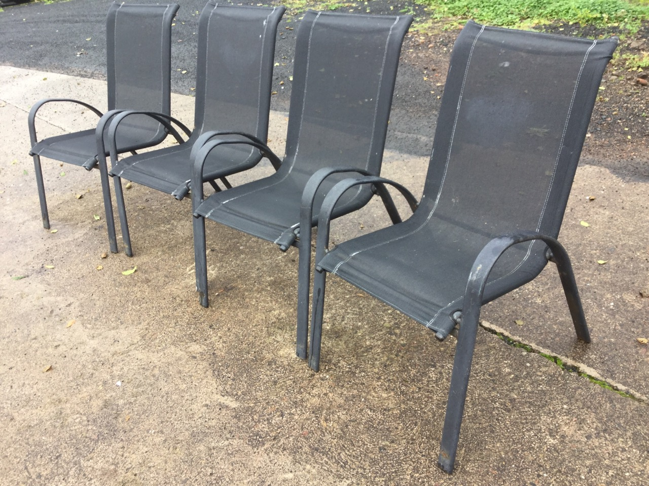 Lot 16 - A set of four garden chairs with fabric backs & seats on arched metal frames. (4)