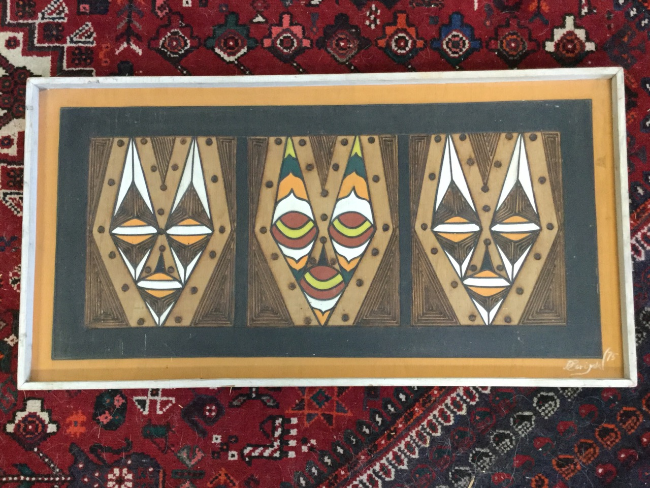 Lot 41 - African school, singed wood and paint on board, three stylised geometric masks, signed