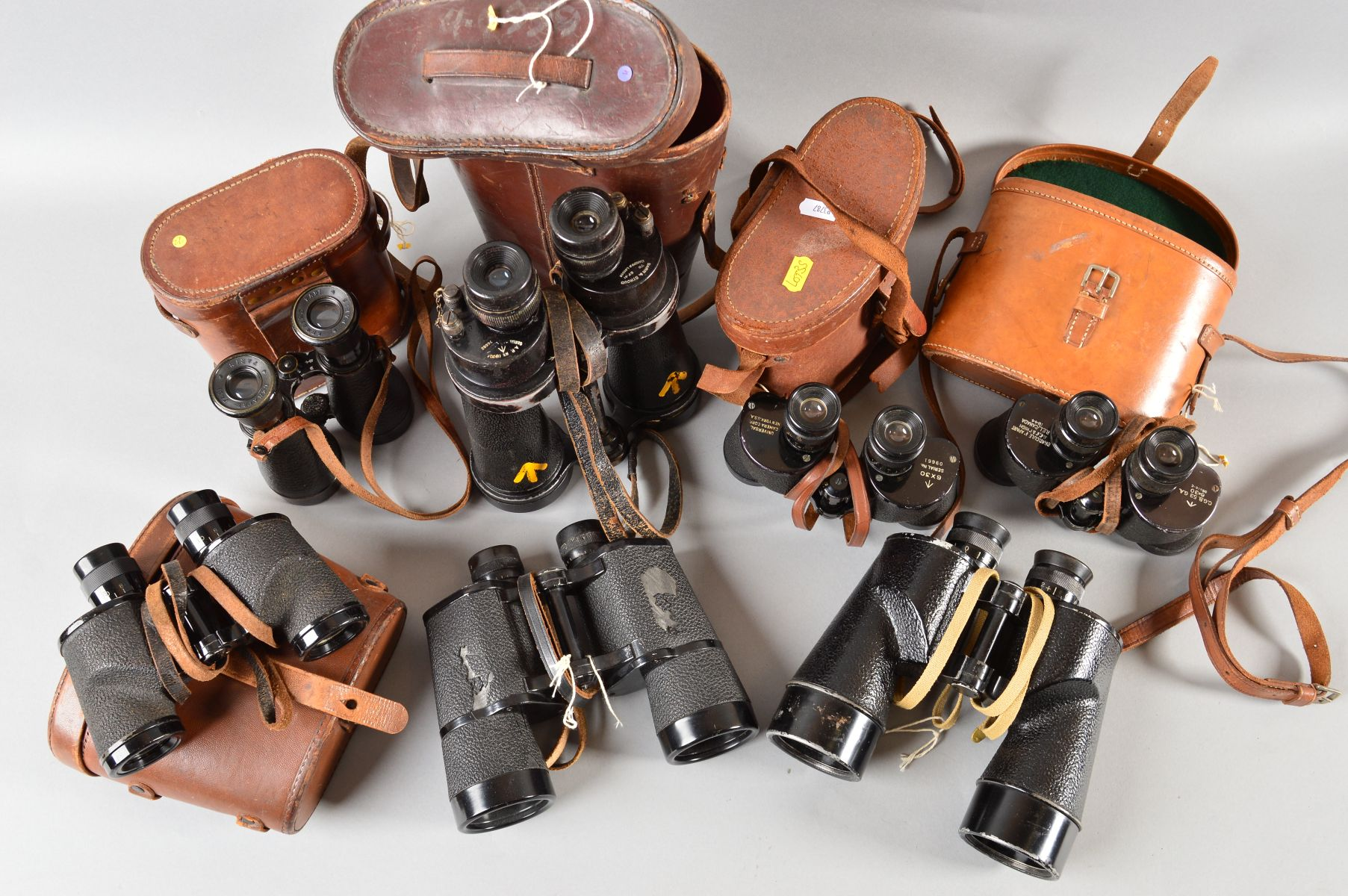 Lot 486 - SEVEN PAIRS OF MILITARY ISSUE BINOCULARS, five pairs with matching cases as follows, Barr & Stroud