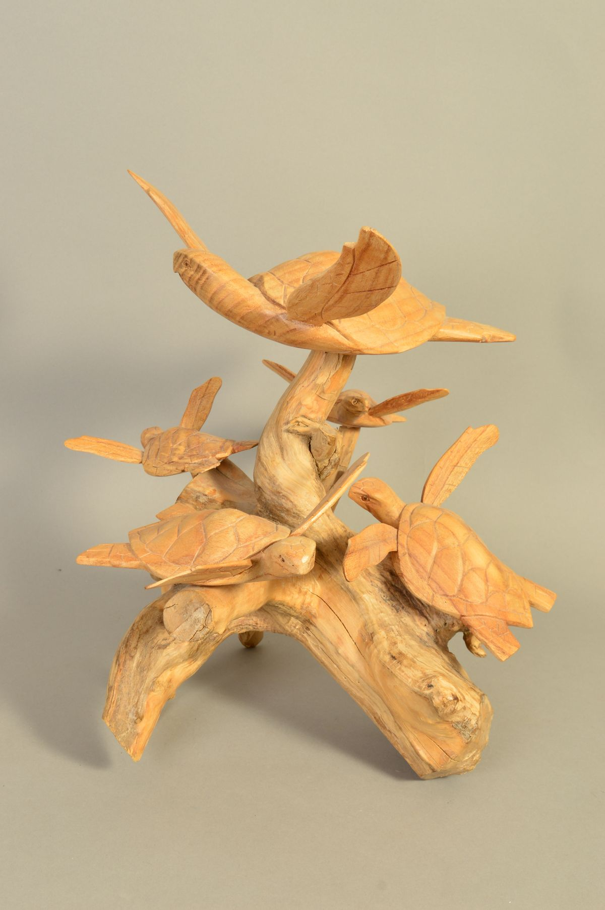 Lot 842 - A MODERN CARVING, TURTLES AROUND A STUMP, height 40cm