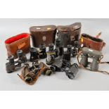 Lot 485 - SEVEN PAIRS OF MILITARY BINOCULARS, some with leather cases, no all matching the optics, makers