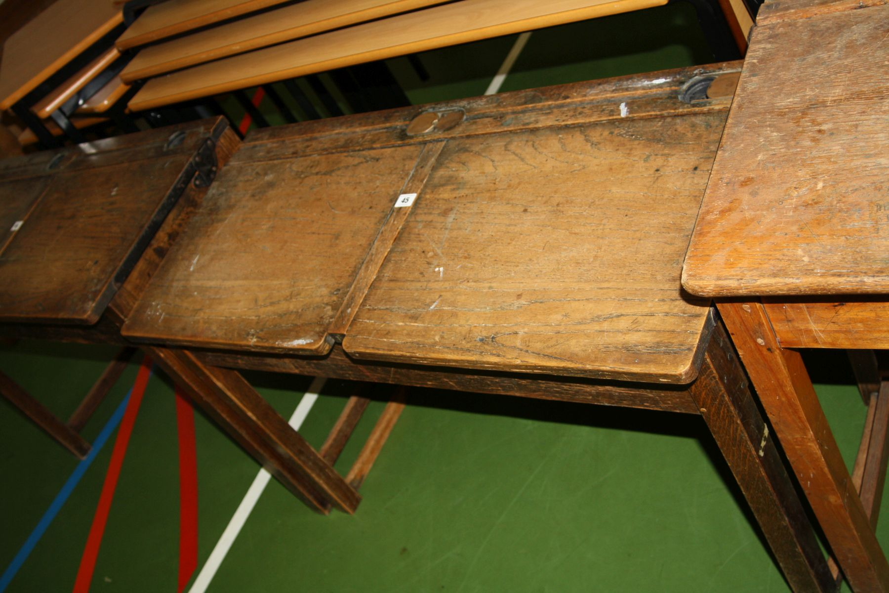 Lot 45 - A VINTAGE DOUBLE SCHOOL DESK, with oak top, two lift up lids, two copper sliding ink well cover