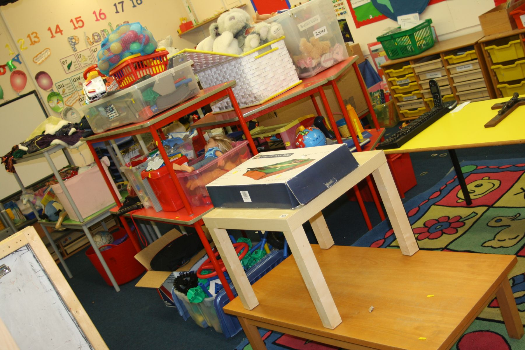 Lot 832 - TWO COFFEE TABLES AND EIGHT BOXES PLUS LOOSE OF CHILDRENS TOYS, including dress up clothes, mini