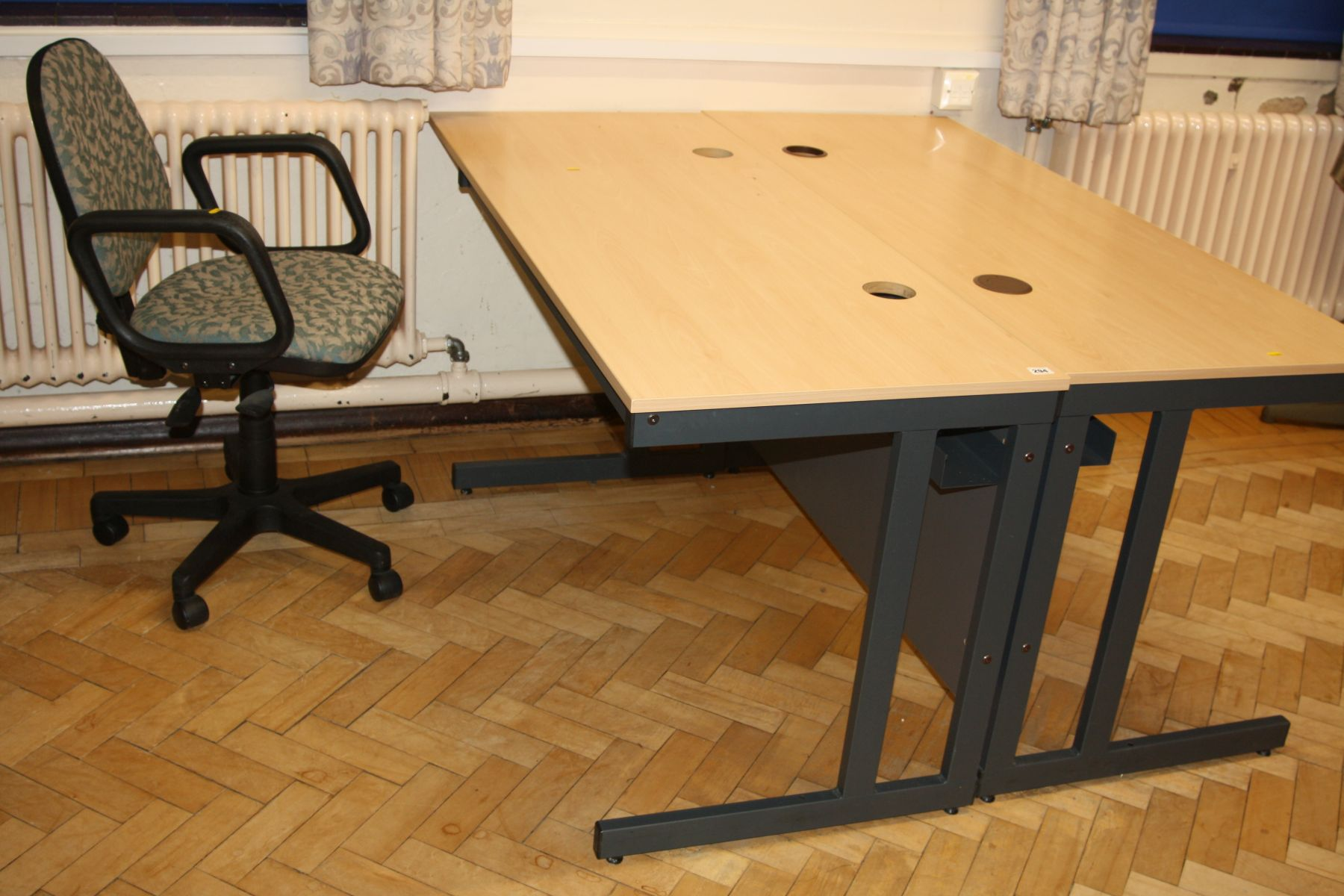 Lot 294 - TWO OFFICE TABLES, with beechwood effect tops over grey metal legs with two cable apertures and