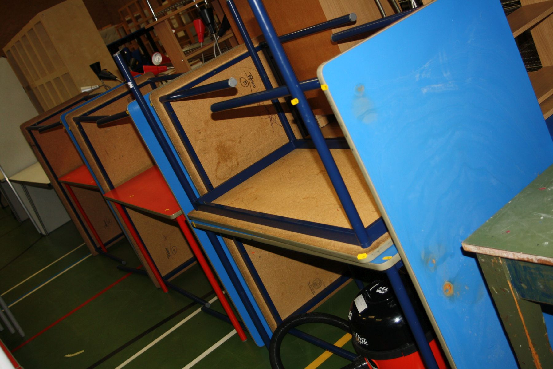 Lot 75 - TEN COLOURED CLASSROOM TABLES, eight blue and two red some stamped Pel to the underside all