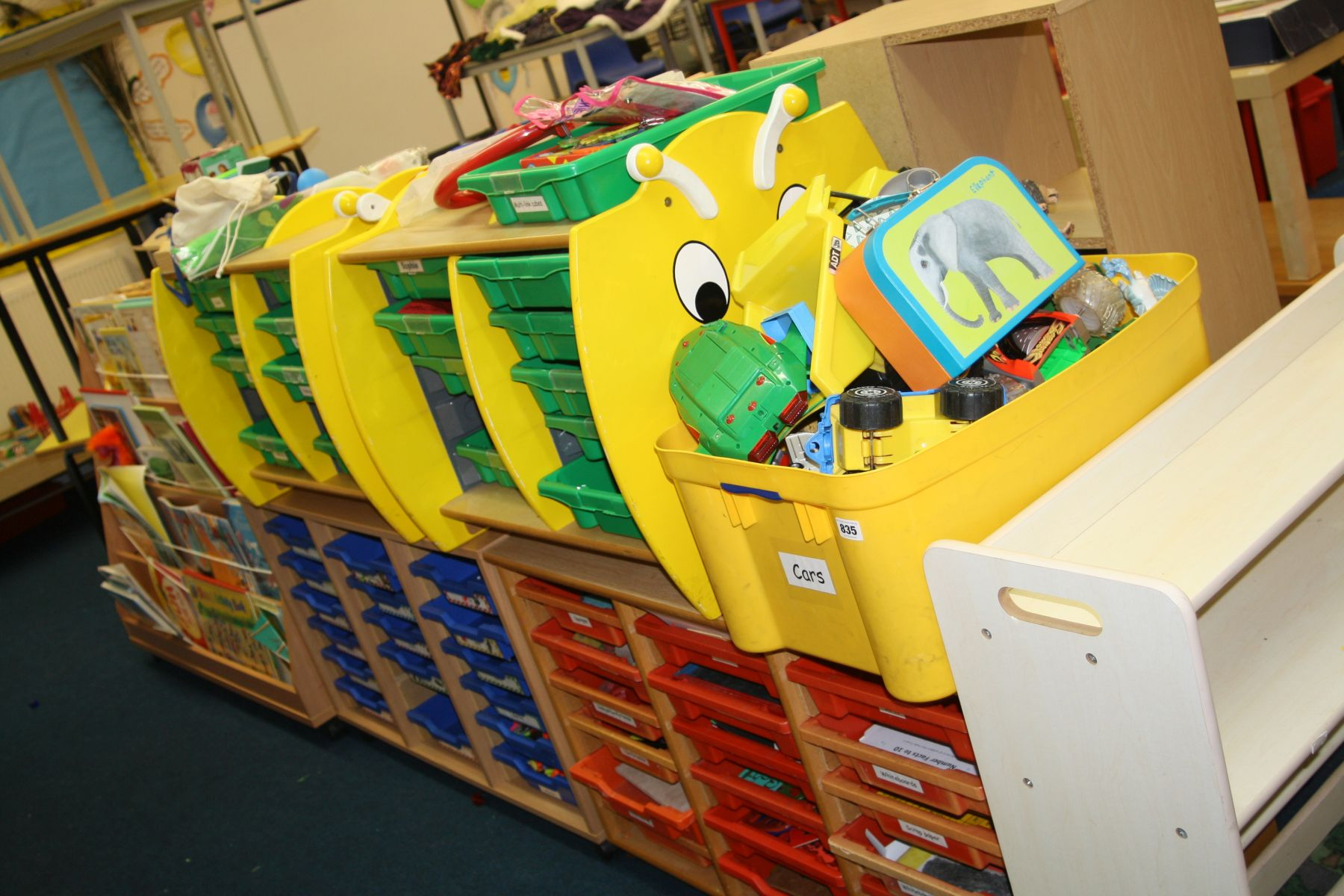 Lot 835 - FOUR SCHOOLS UNITS, with plastic drawers, a bookcase containing pre school books and toys