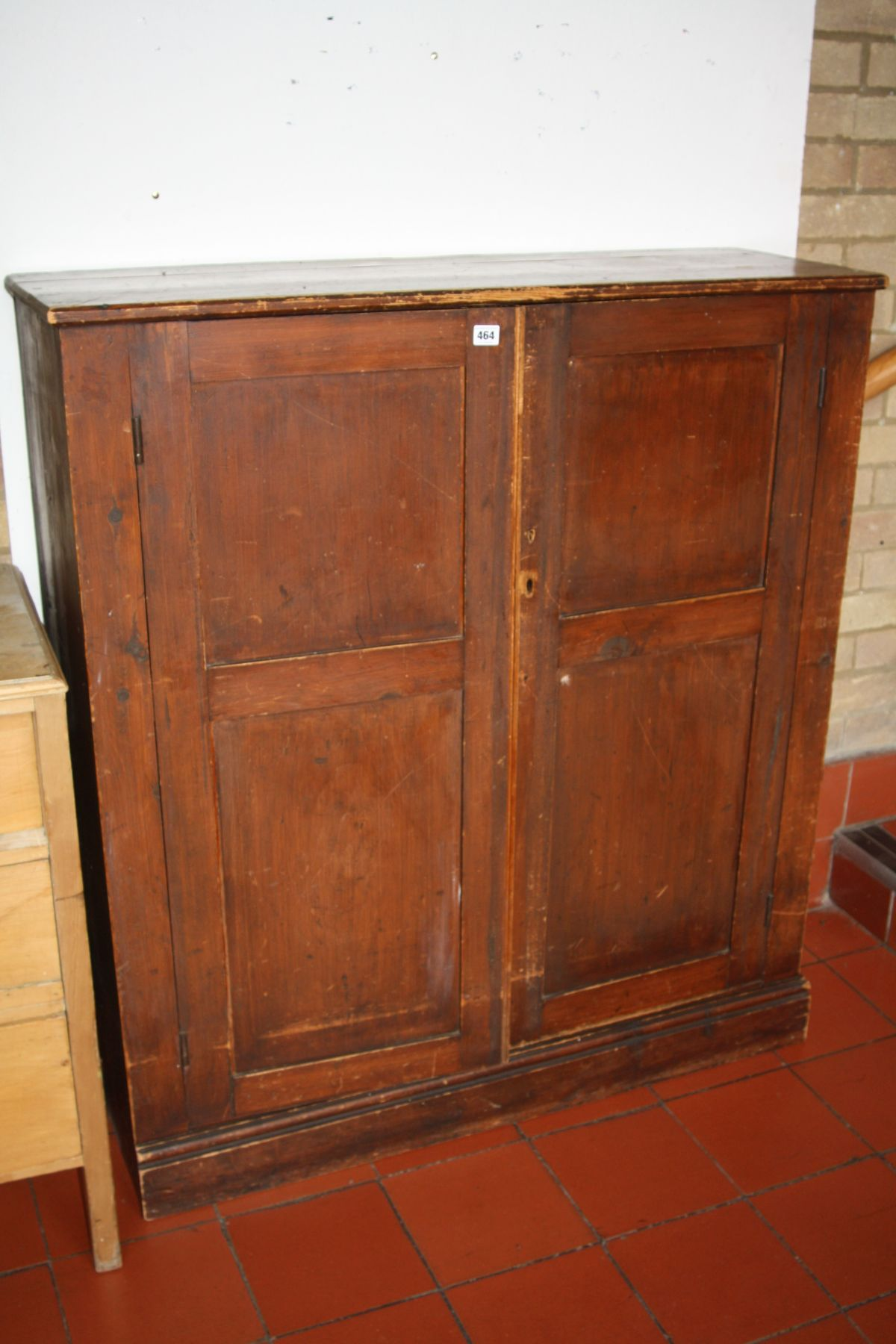 Lot 464 - A STAINED PINE EDWARDIAN TWO DOOR CUPBOARD, with two full and one half shelves to the interior