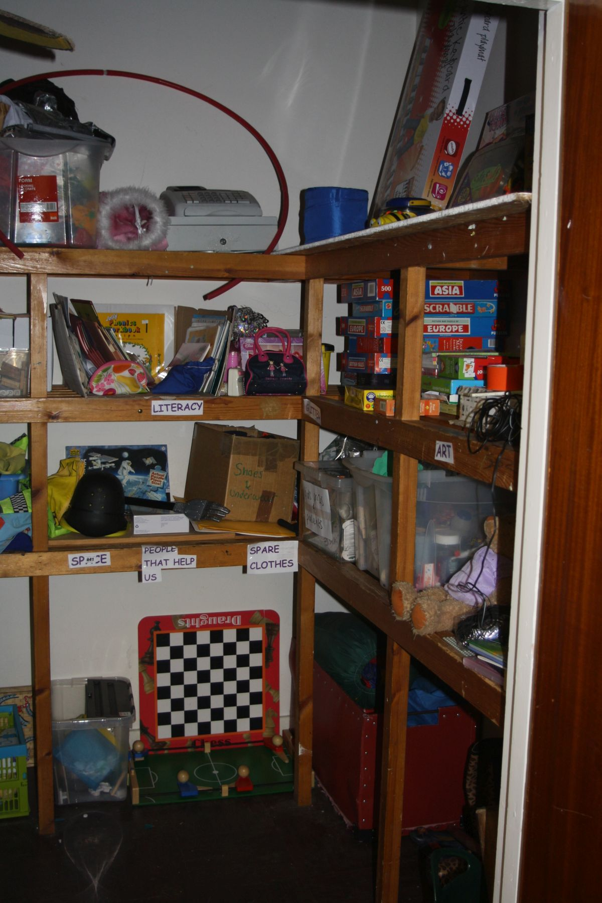 Lot 841 - A STORE CUPBOARDS CONTENTS, including a large quantity of games and child's toys