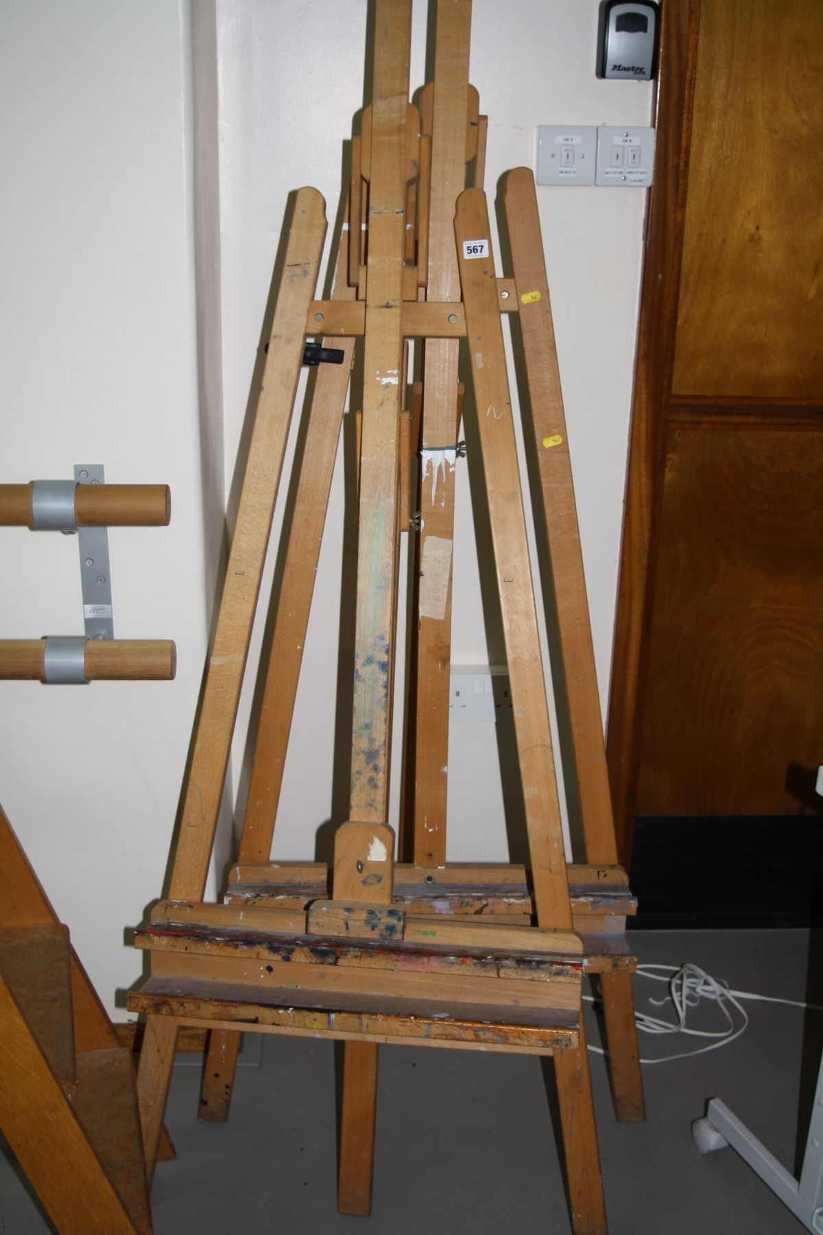 Lot 567 - TWO MODERN ADJUSTABLE ARTISTS EASELS, 185cm high (s.d.)